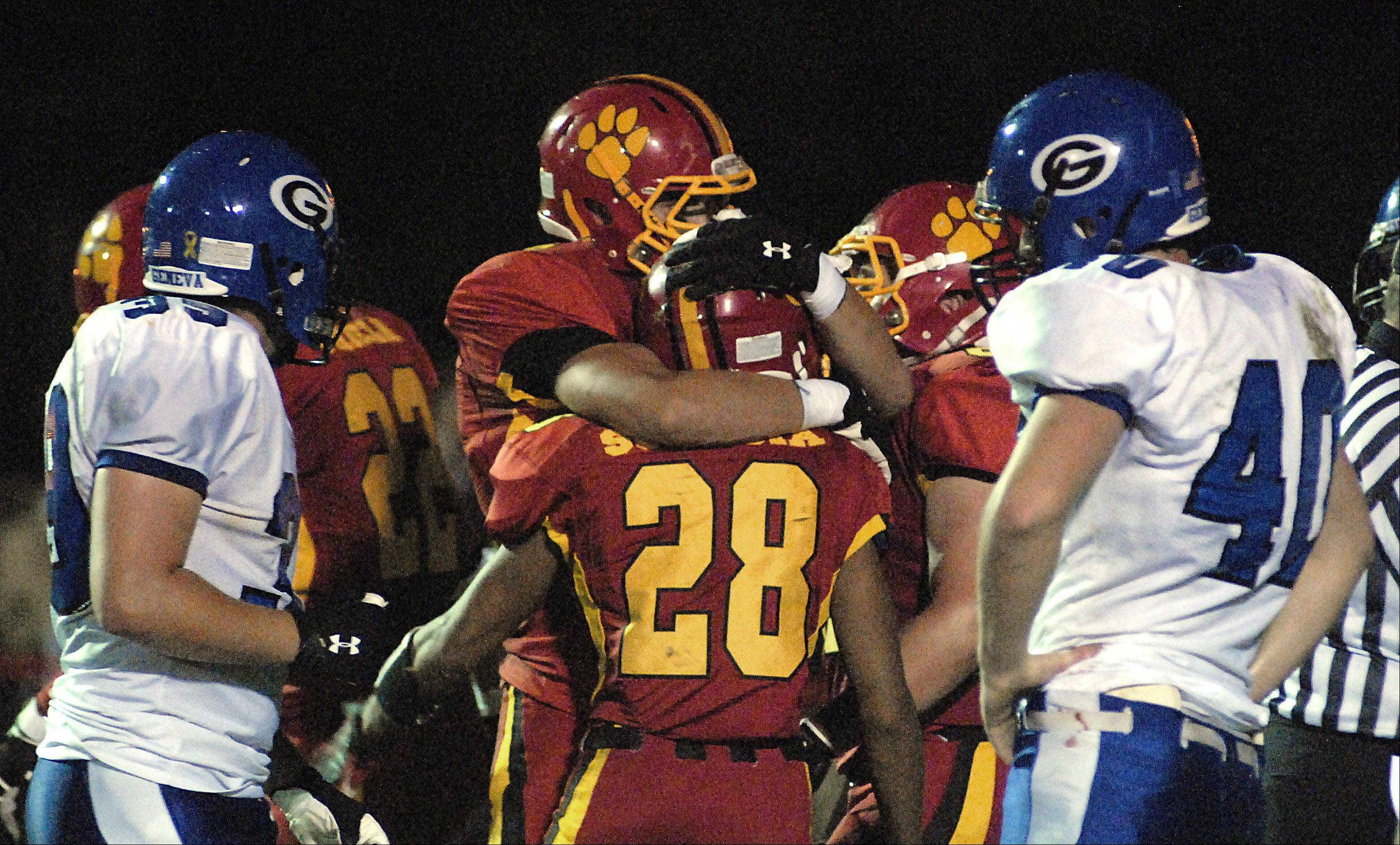 Batavia's Sebastian Vermaas congratulates Anthony Scaccia on a second quarter touchdown.