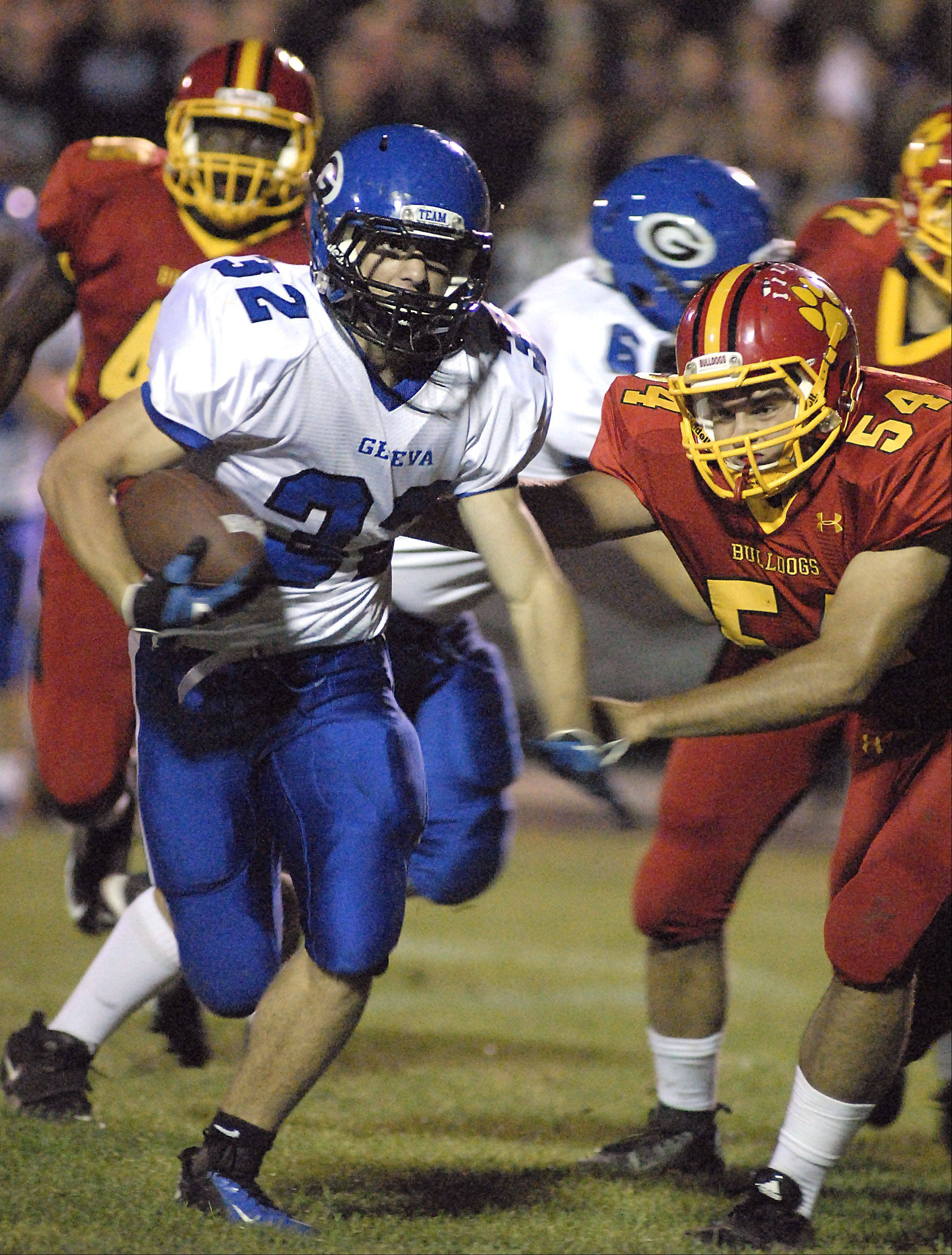 Geneva's Bobby Hess pushes away Batavia's Michael Watson in the second quarter.