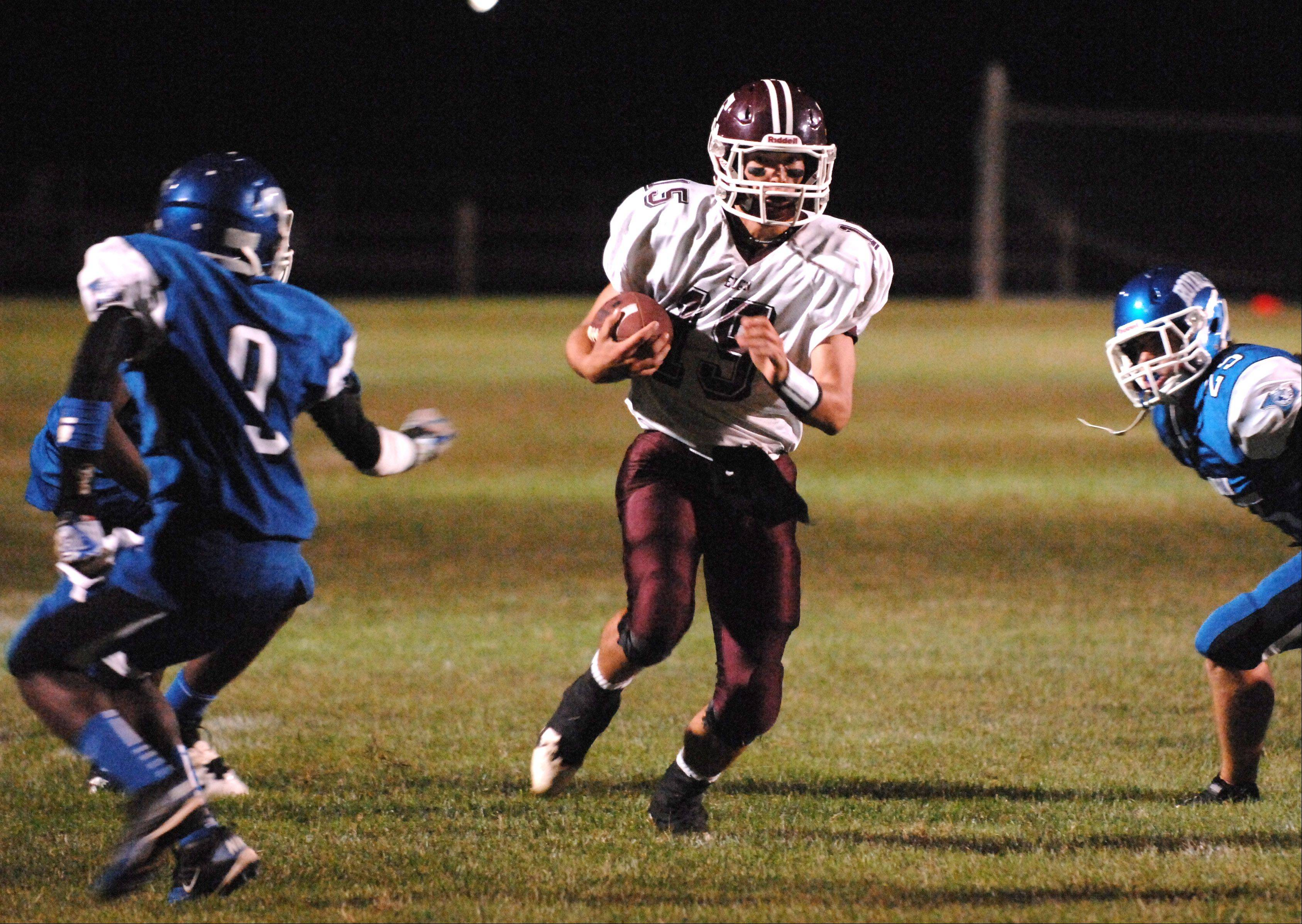Elgin's Ryan Sitter breaks a run for a second half touchdown .