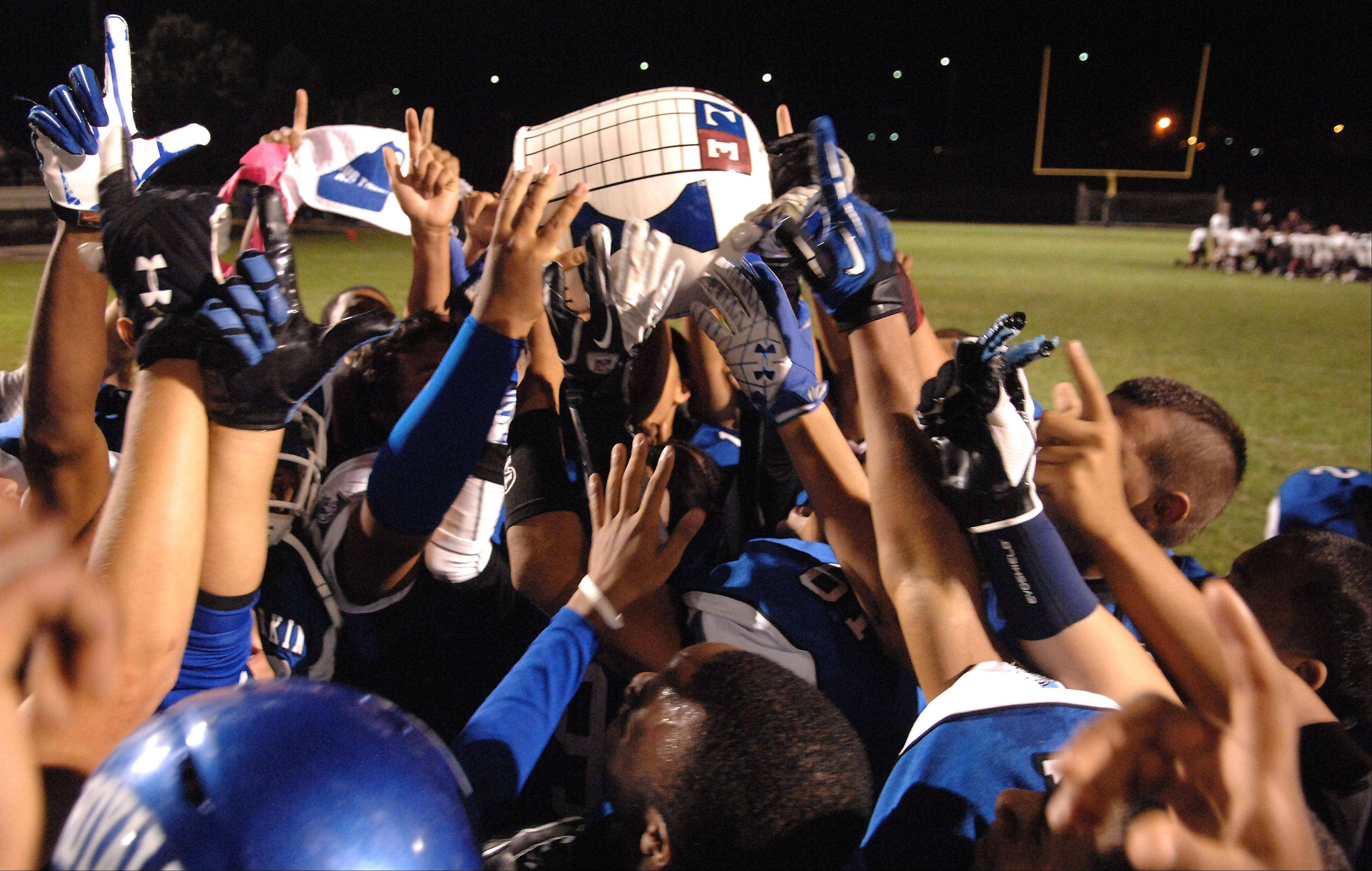 Larkin players celebrate with the jug following their win over Elgin during Friday's game at Elgin High School.