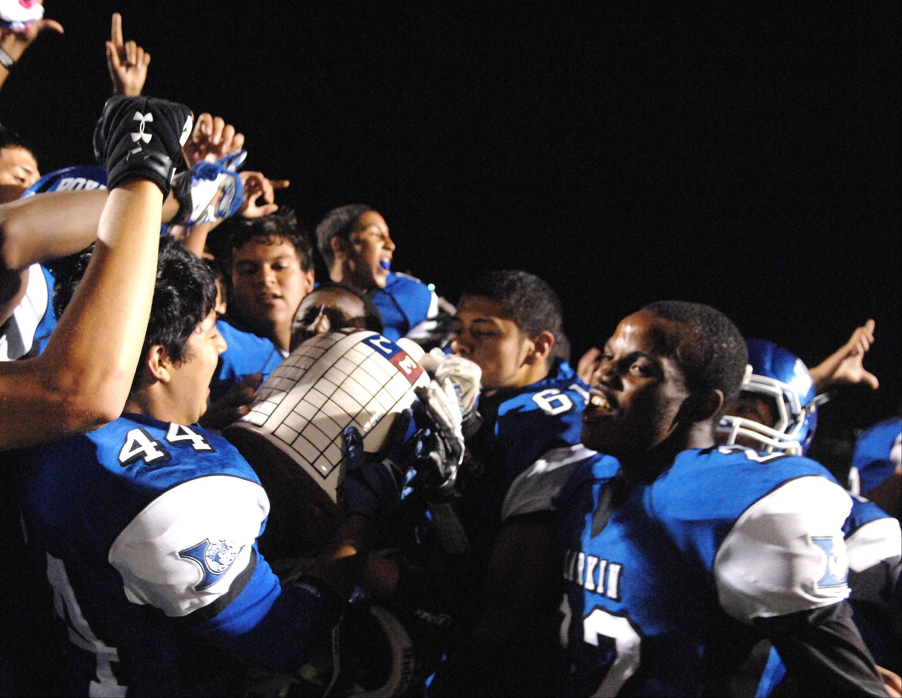 Larkin players celebrate with the Town Jug following their win over Elgin during Friday night's game at Elgin High School.