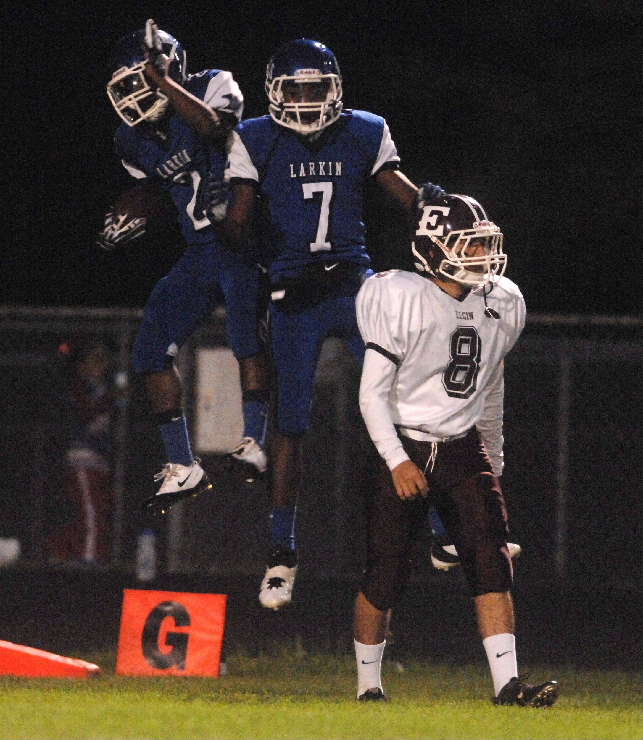 Larkin's Damion Clemons (2) celebrates the first touchdown of the game with teammate Dante Bonds (7) during Friday's game at Elgin High School.