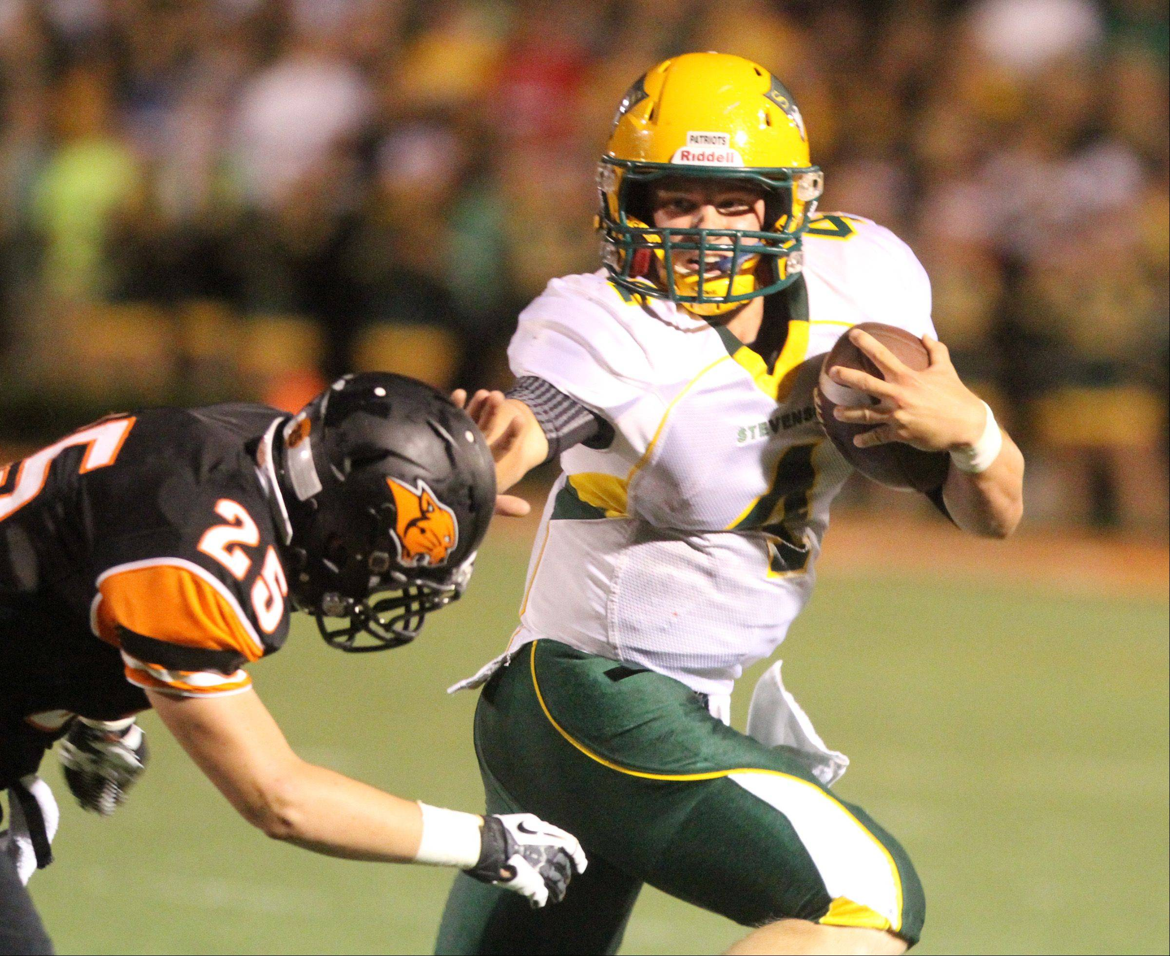 Stevenson quarterback Willie Bourbon scrambles after attempting to pass.