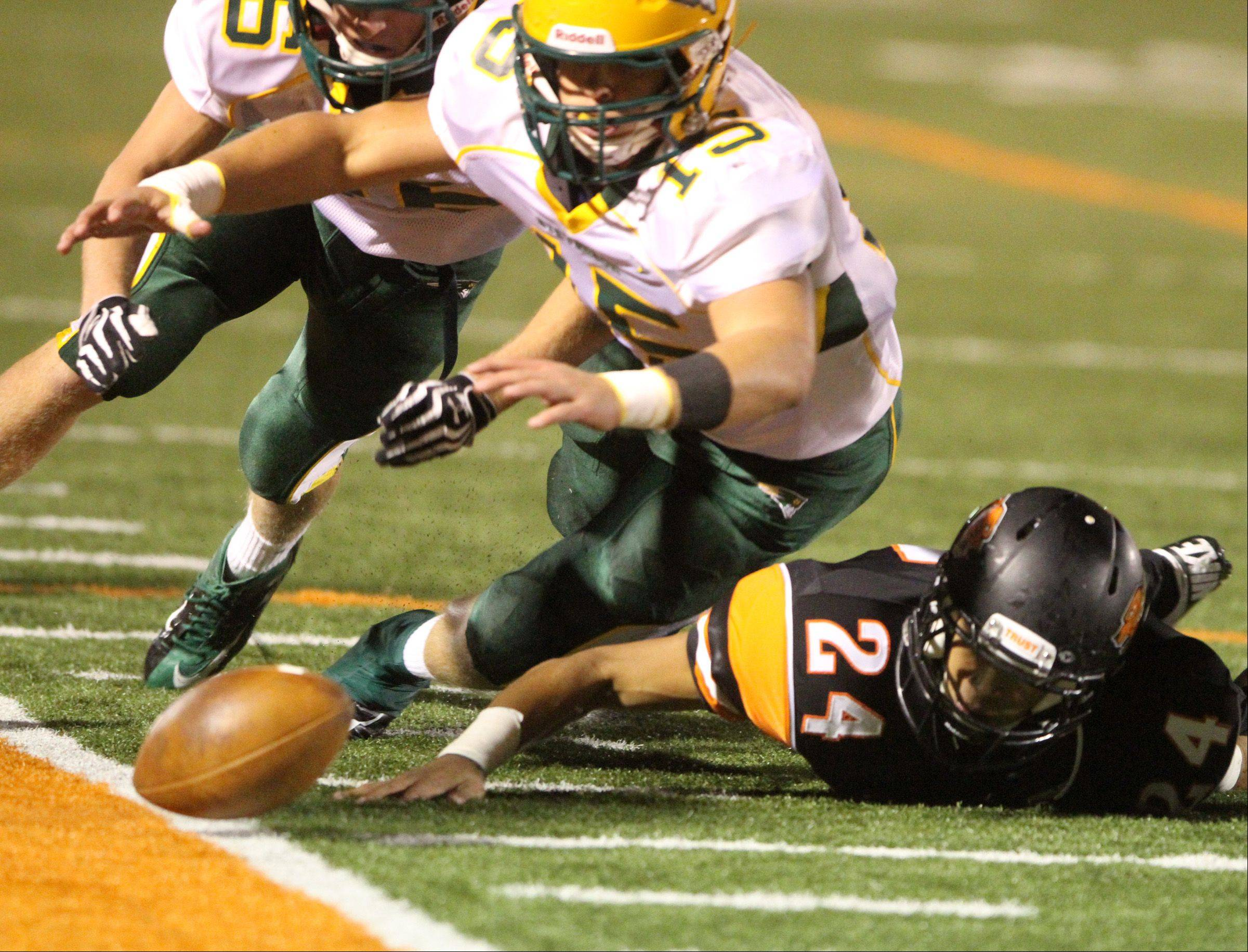 Stevenson's Sean O'Connell dives for the ball after a Libertyville fumble.