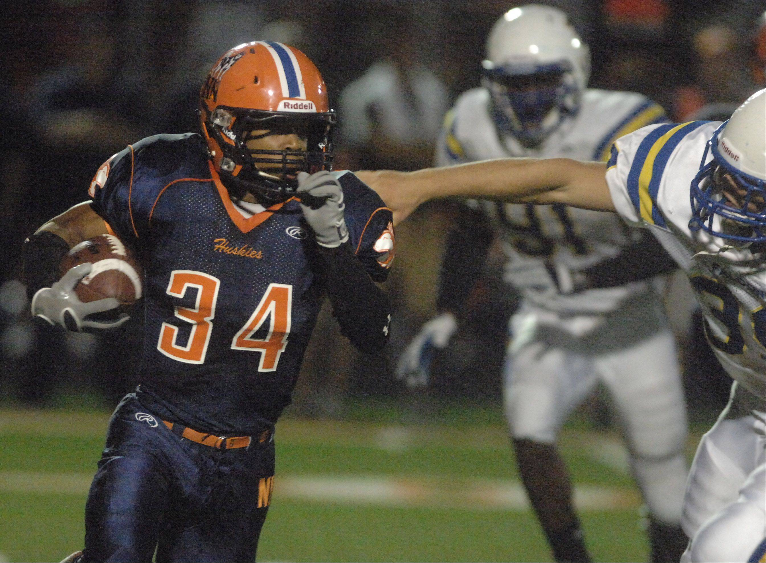 Sharad Crosby of Naperville North moves the ball.