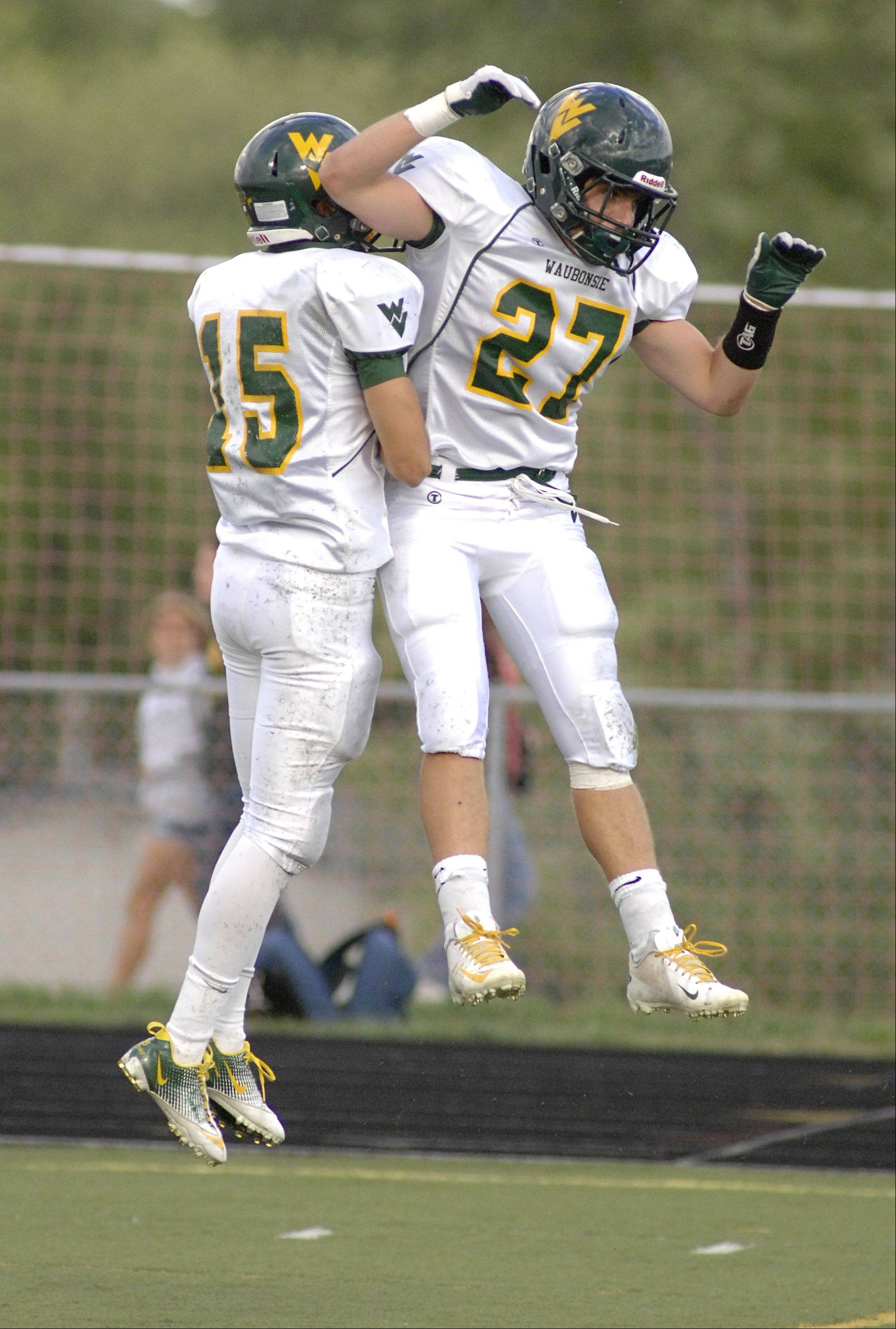 Waubonsie Valley's Kyle Neese, left, celebrates his touchdown in the second quarter with teammate Austin Guido on Saturday, September 8.
