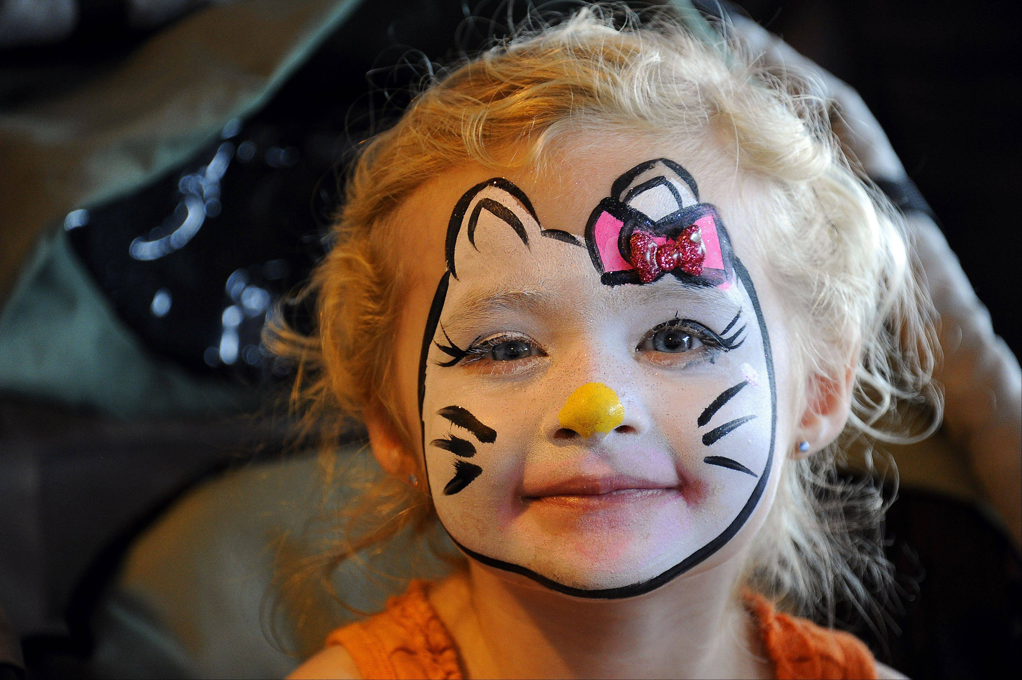 Looking like the cat in the hat with her painted face, Savannah Alexander, 3, of Pingree Grove shows her excitement with an award winning smile on the second day of Septemberfest in Schaumburg on Saturday.
