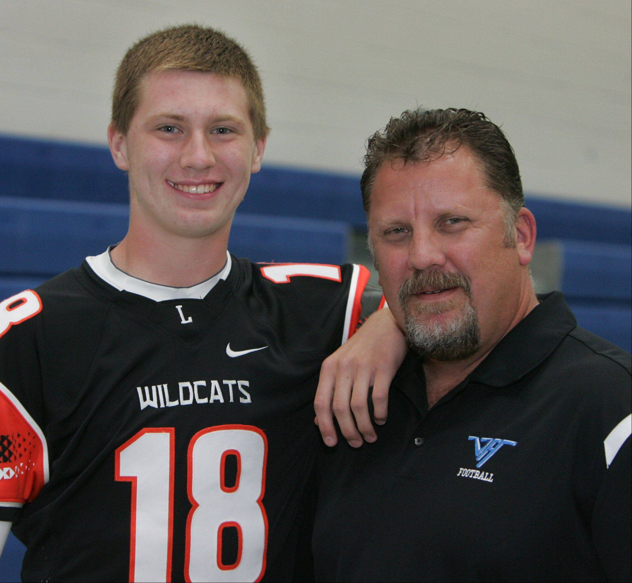 Vernon Hills football coach Tony Monken, right, with his son, Anthony, who plays for Libertyville.