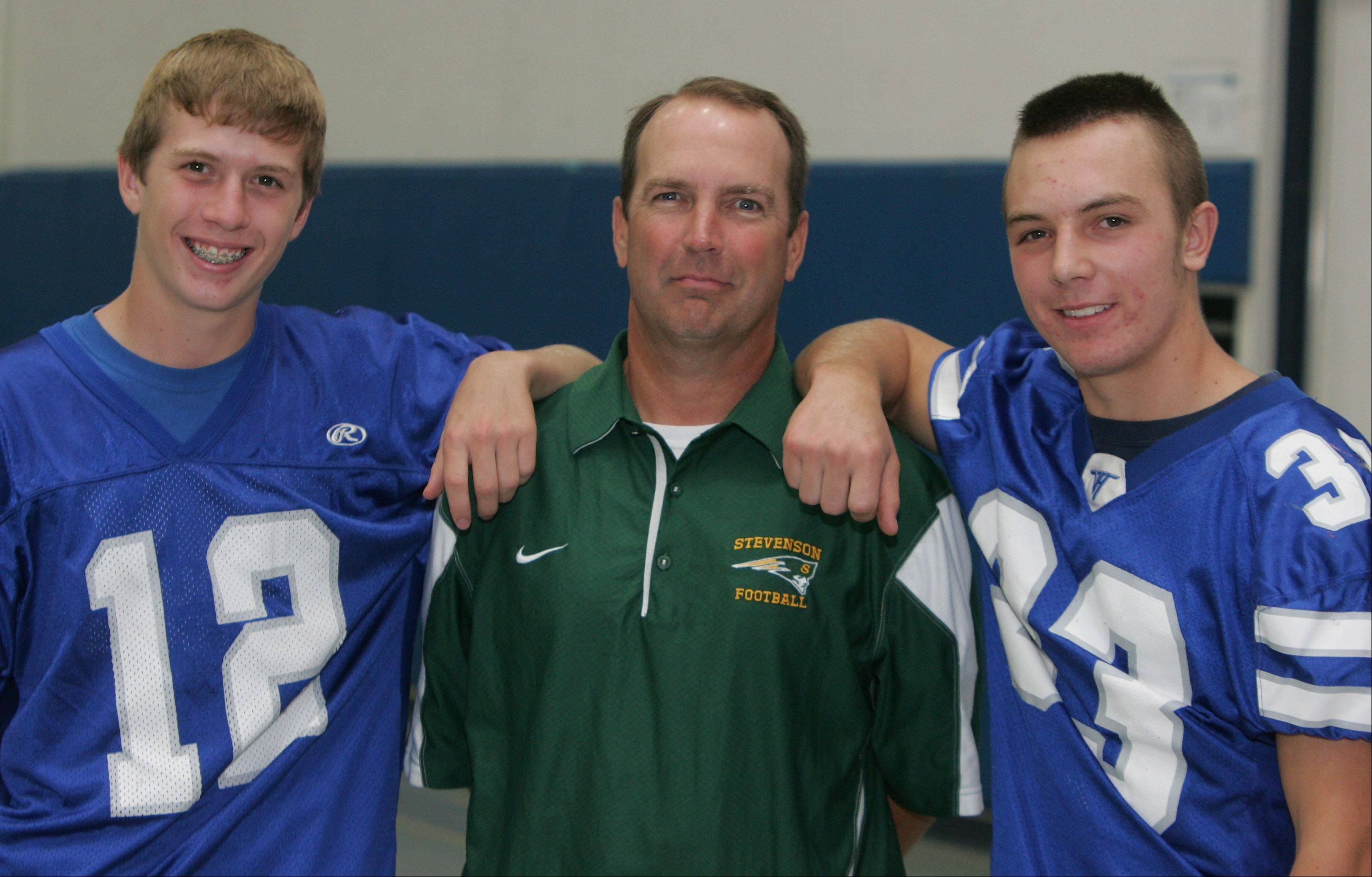 Stevenson football coach Bill McNamara, center, with his sons Connor (12) and Dylan (33), who play for Vernon Hills.