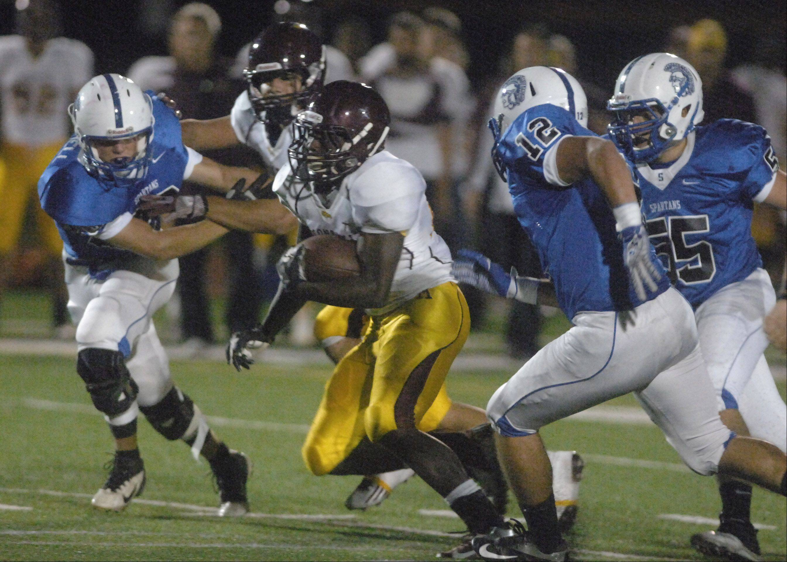 Dimitri Taylor of Montini runs with the ball during the Montini vs. St Francis football game Friday in Glen Ellyn.