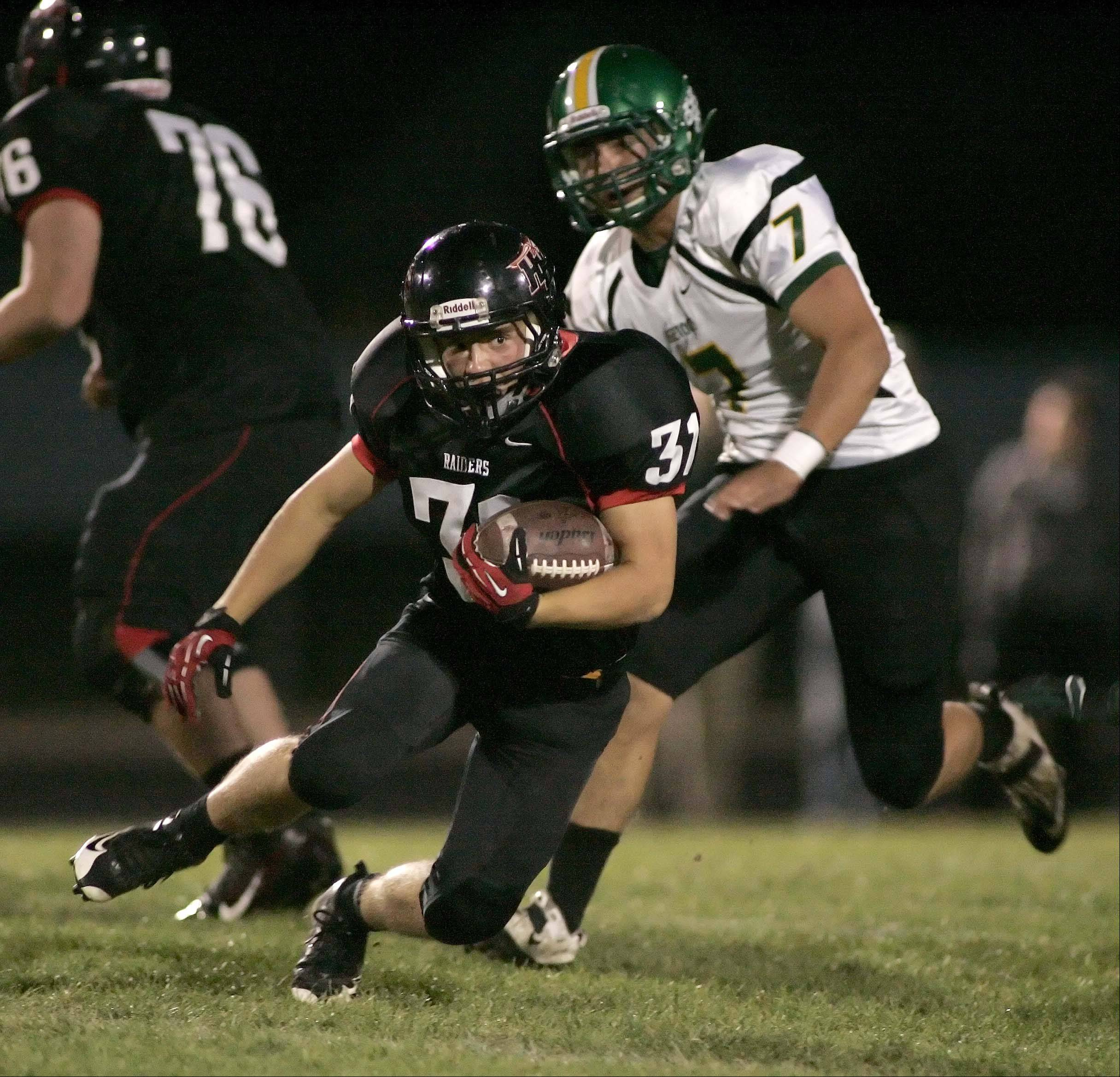 Huntley's Jake Scalise (31) moves past Crystal Lake South's Brendan Chrystal Friday night at Huntley.