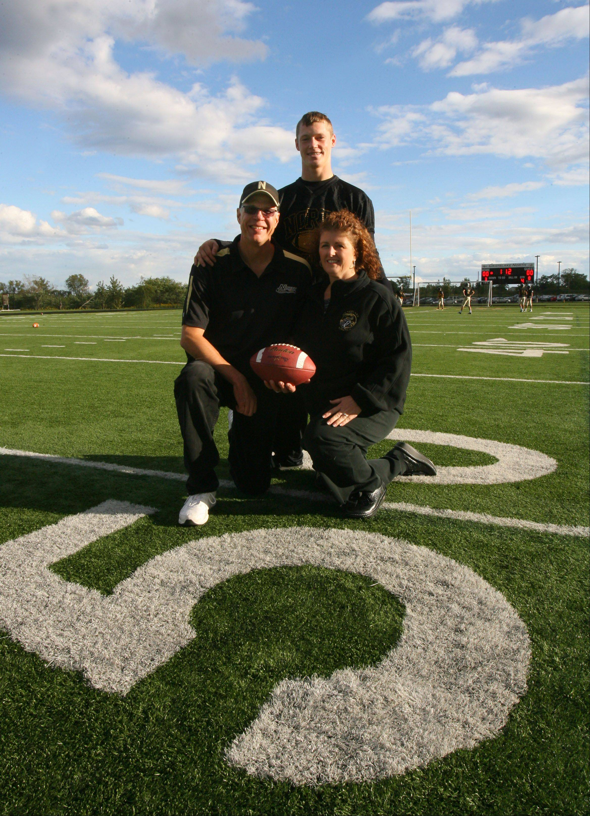 Grayslake North senior linebacker/running back David Collins has had a rough ride in his young life, but Jamie and Jay Gustafson of Lake Villa now have legal guardianship of Collins. Their support has helped him work through many difficult personal issues.