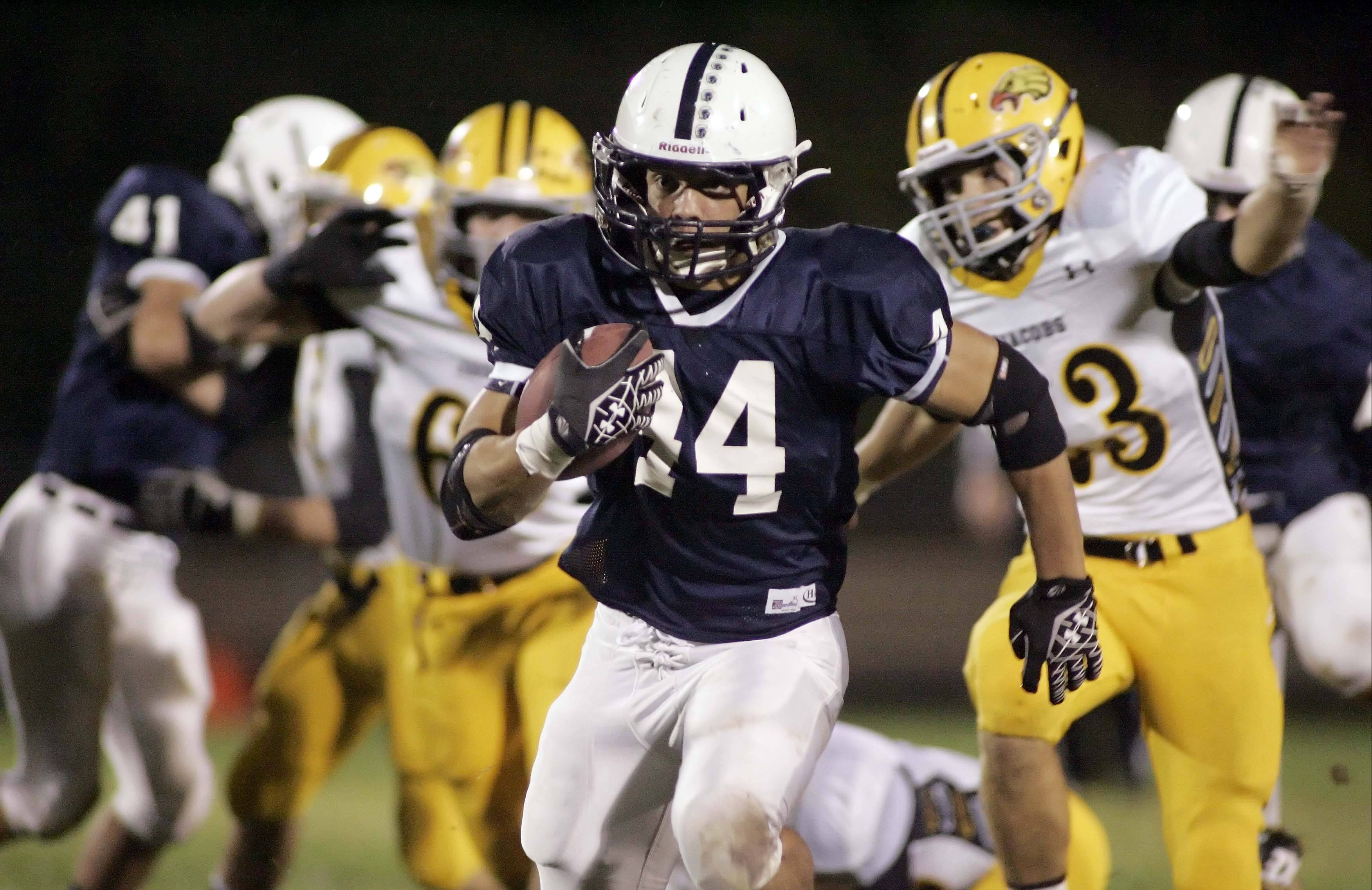 Cary-Grove's Kyle Norberg (44) runs for a touchdown during the first quarter of the Trojans' win over Jacobs Friday night in Cary.
