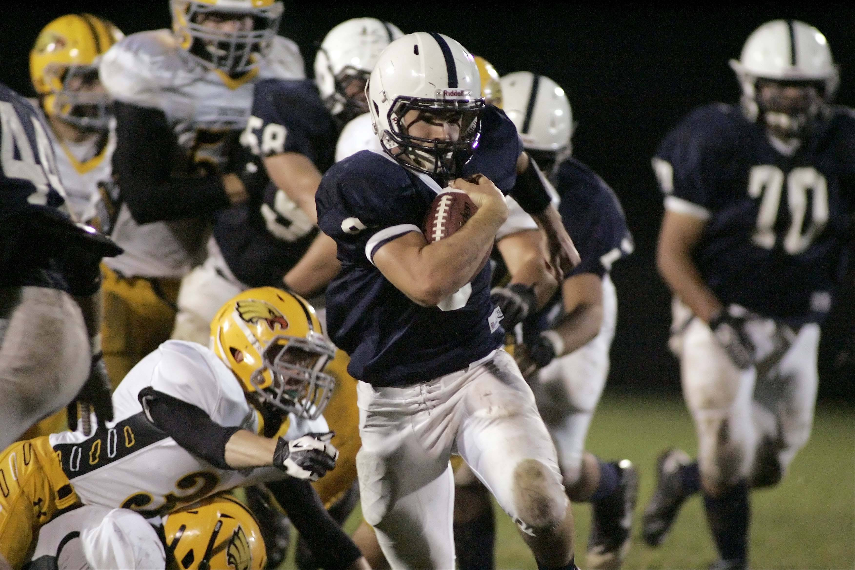 Cary-Grove's Quinn Baker (9) goes in for a touchdown during the second quarter against Jacobs Friday night in Cary.