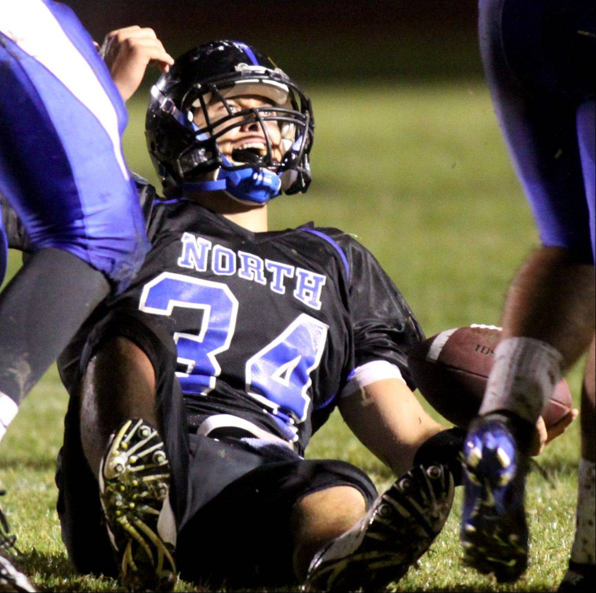 St. Charles North's Evan Kurtz reacts after picking up a first down against Geneva at St. Charles North on Friday night.