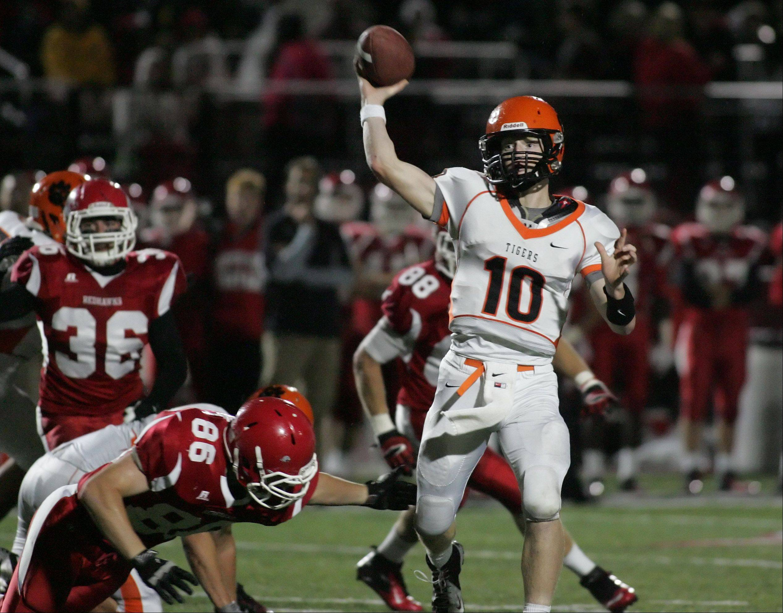 Wheaton Warrenville South quarterback Ryan Graham makes a pass .