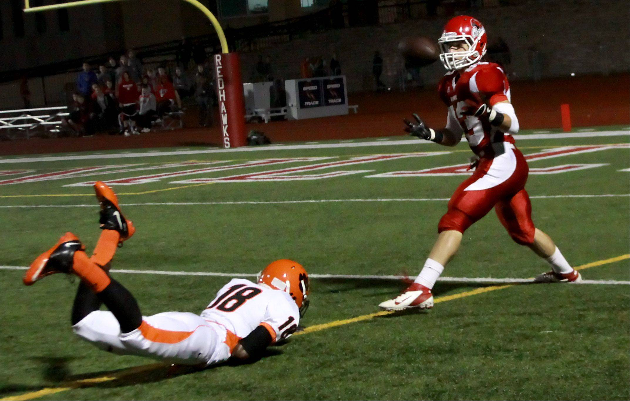 Ben Andreas of Naperville Central makes a catch for a touchdown.