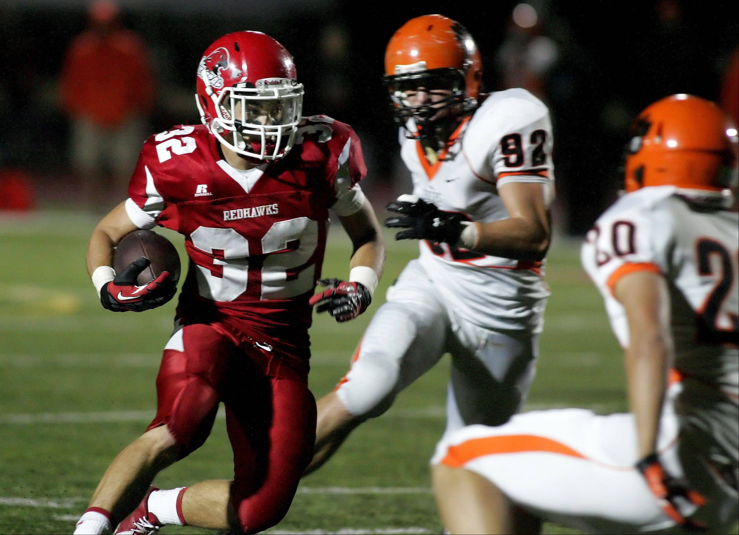 Nick Thomas of Naperville Central makes his way through the Wheaton Warrenville South defense.