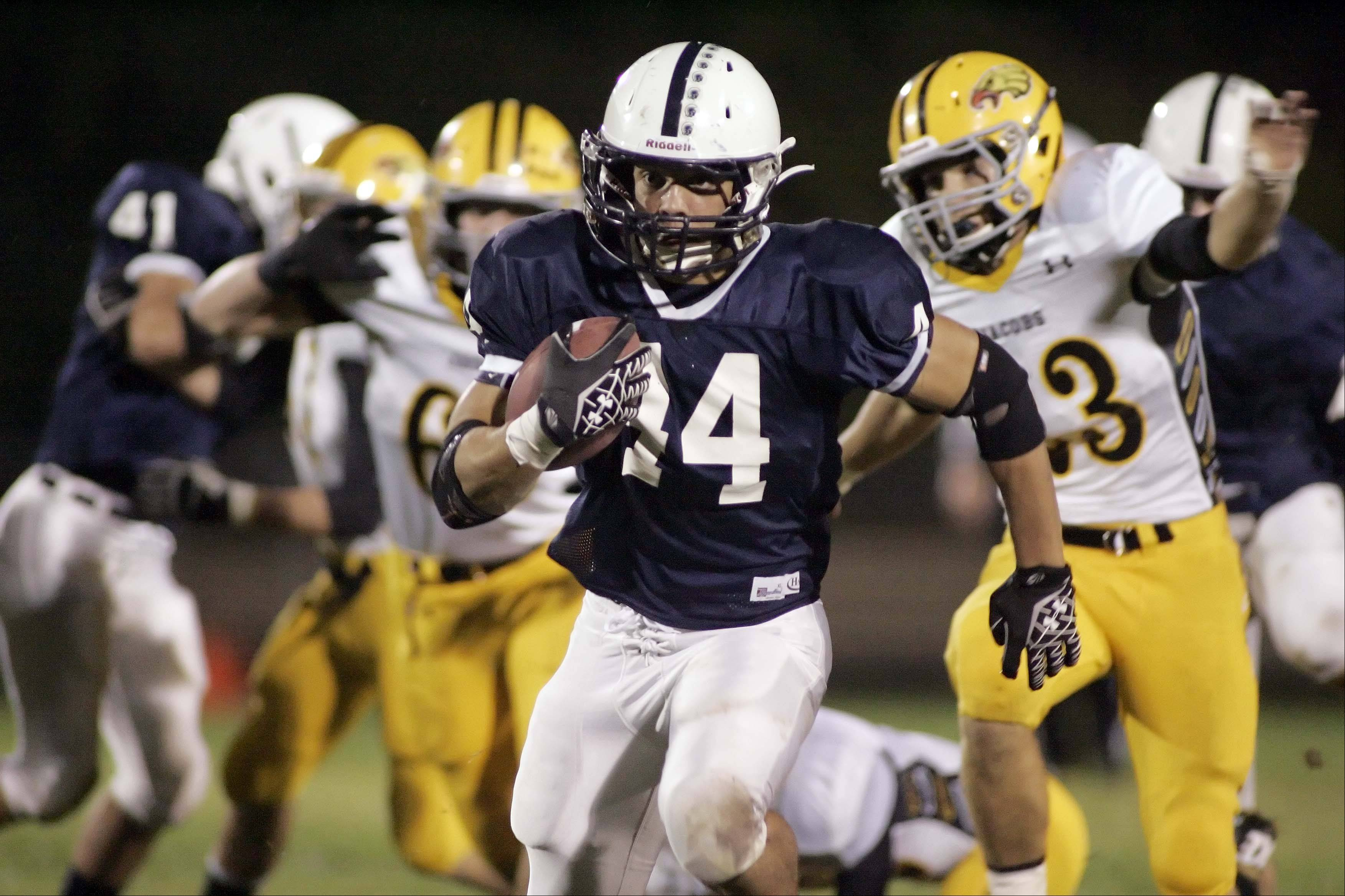 Cary-Grove's Kyle Norberg runs for a touchdown during the first quarter.