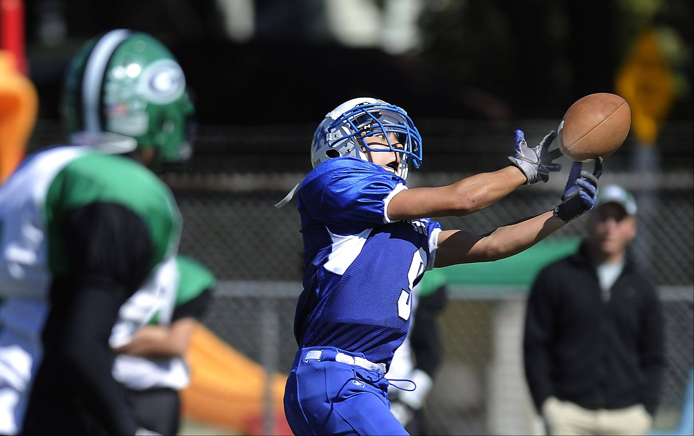 Christian Liberty wide receiver J D Dulinsky just misses a pass touching his fingertips late in the second quarter from the quarterback Gabe Grob in Saturday's game in Arlington Heights.