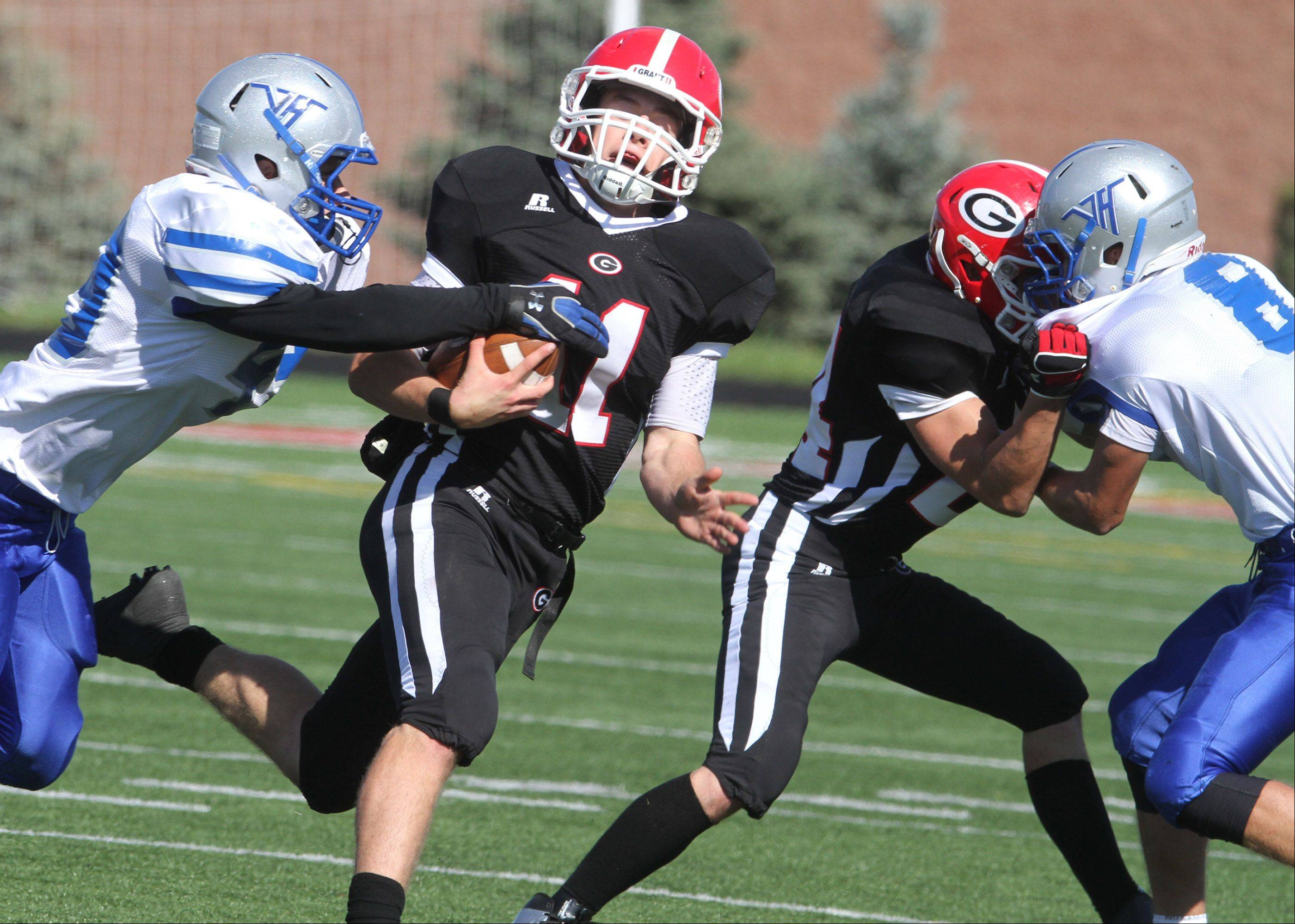 Grant quarterback Kyle Whitman picks up yardage against Vernon Hills at Grant on Saturday.