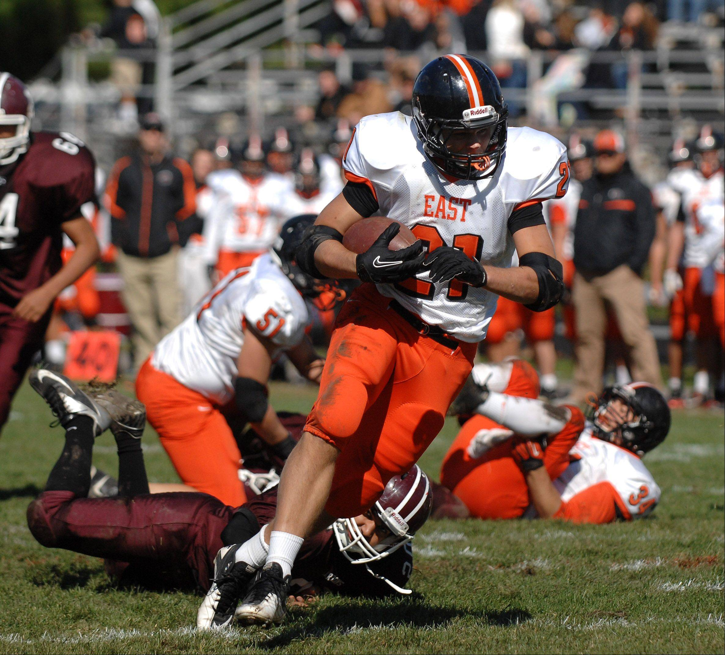 St. Charles East's Erik Anderson shed a number of Elgin tacklers en route to a second quarter touchdown during Saturday's game at Memorial Field in Elgin.