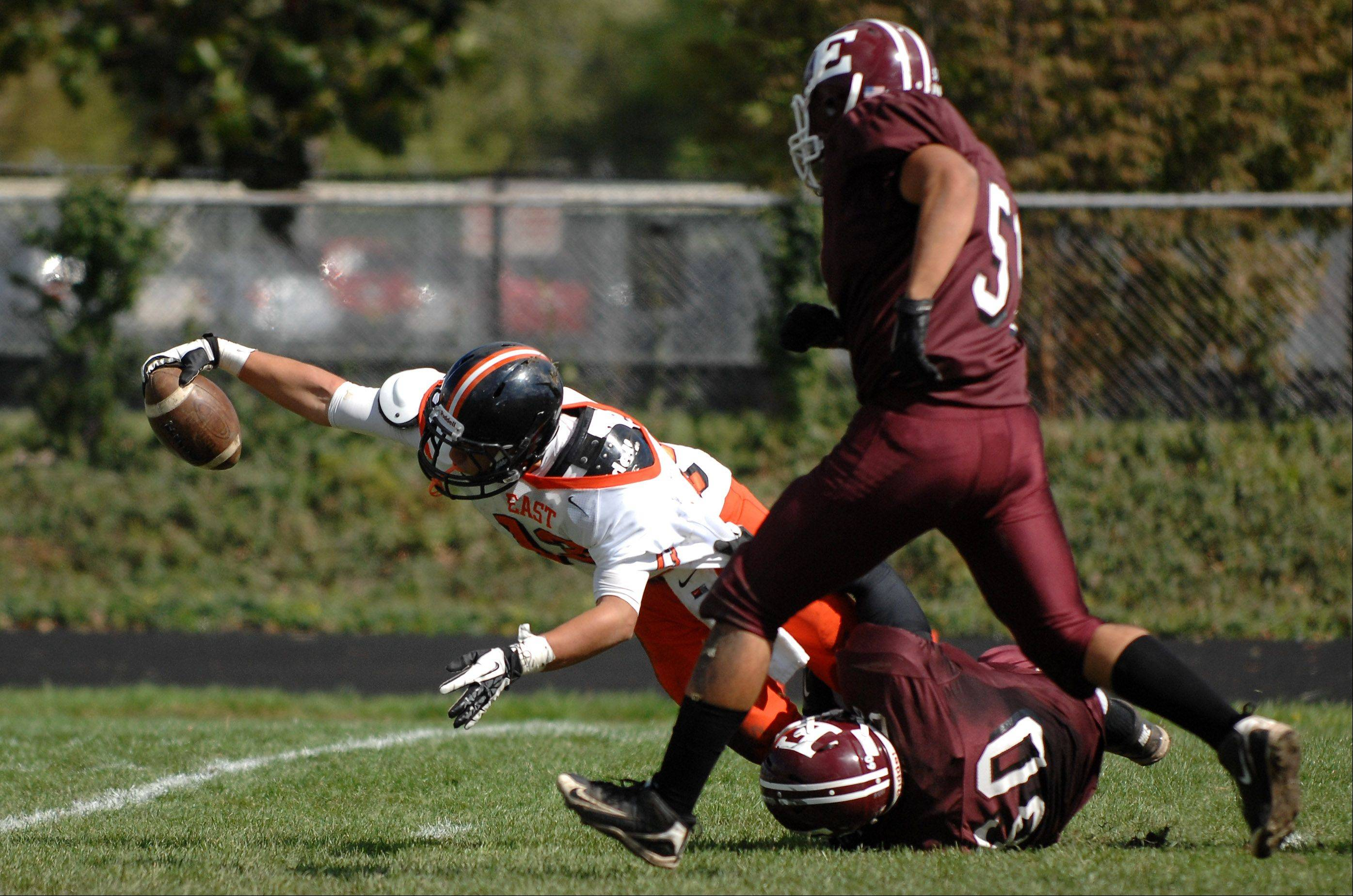 St. Charles East's Anthony Sciarrino dives and stretches for the goal line while scoring on a punt return against Elgin during Saturday's game at Memorial Field in Elgin.