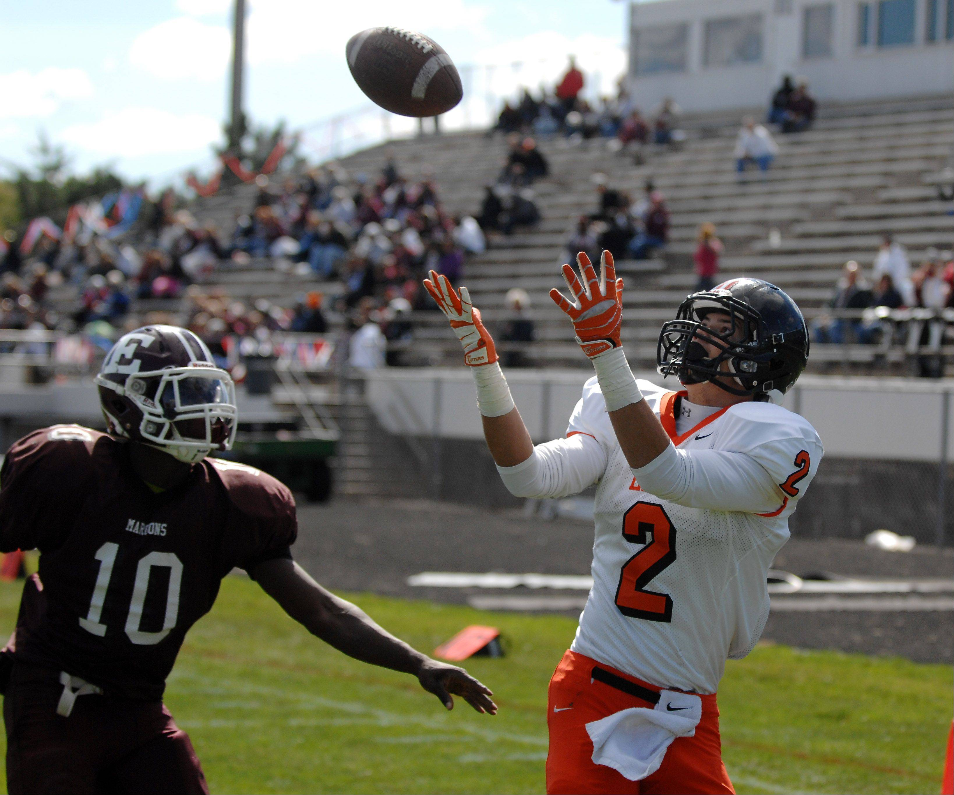 St. Charles East's Brannon Barry watches the ball into his hands for a first-quarter touchdown reception against Elgin during Saturday's game at Memorial Field in Elgin.
