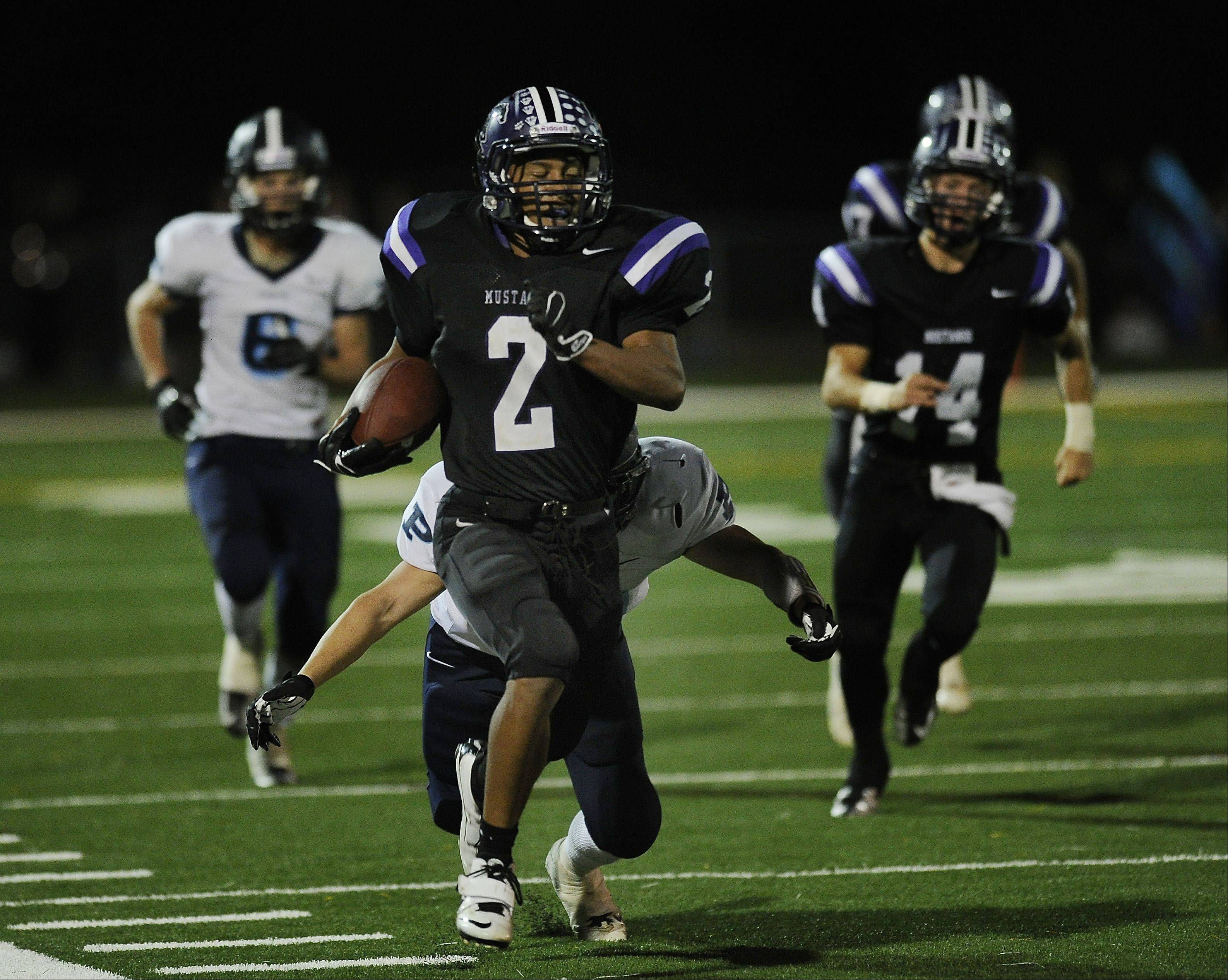 Rolling Meadows Andre Campbell runs the ball in the first half.