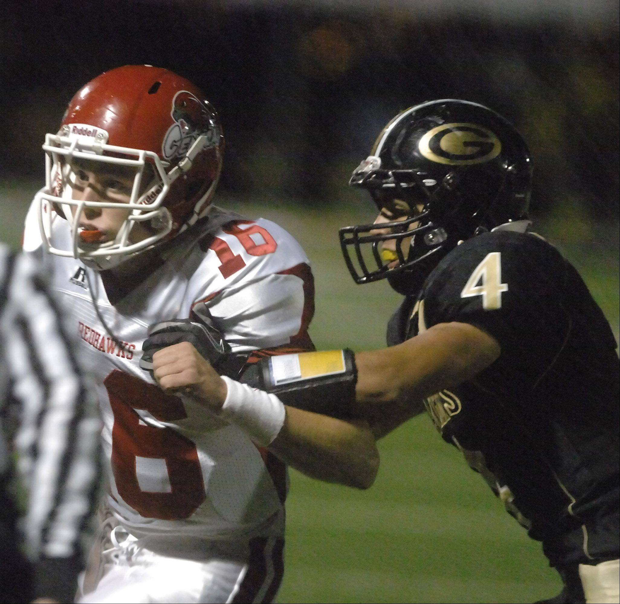 Jake Kolbe of Naperville Central is pulled down by Alex Smith of Glenbard North.