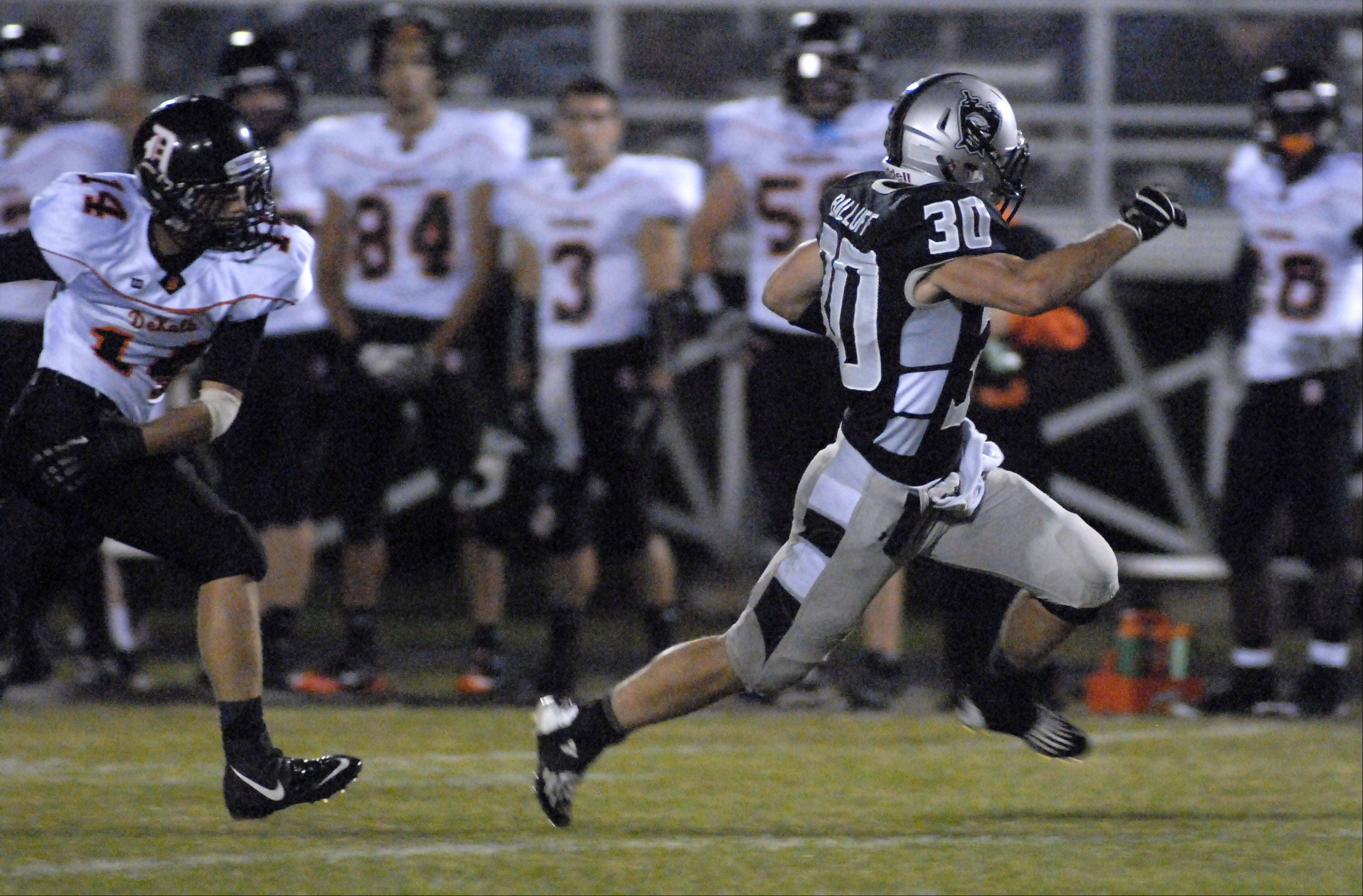Kaneland's Jesse Balluff shakes off DeKalb's Jake Young in the first quarter en route to the end zone for a touchdown.