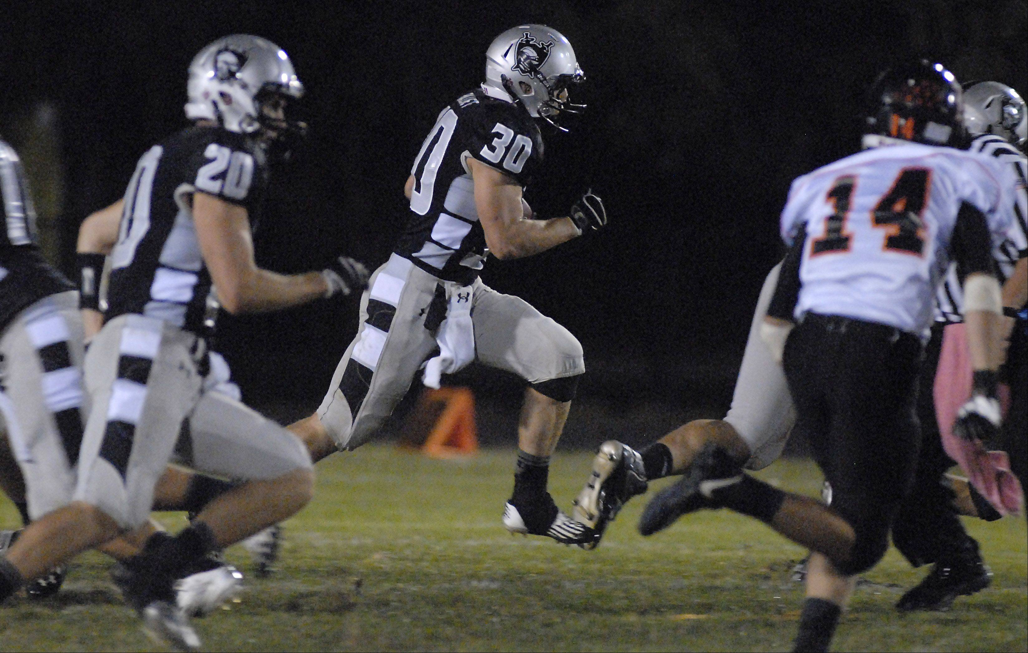 Kaneland's Jesse Balluff sprints through a hole in DeKalb's defense on his way to the end zone in the first quarter.