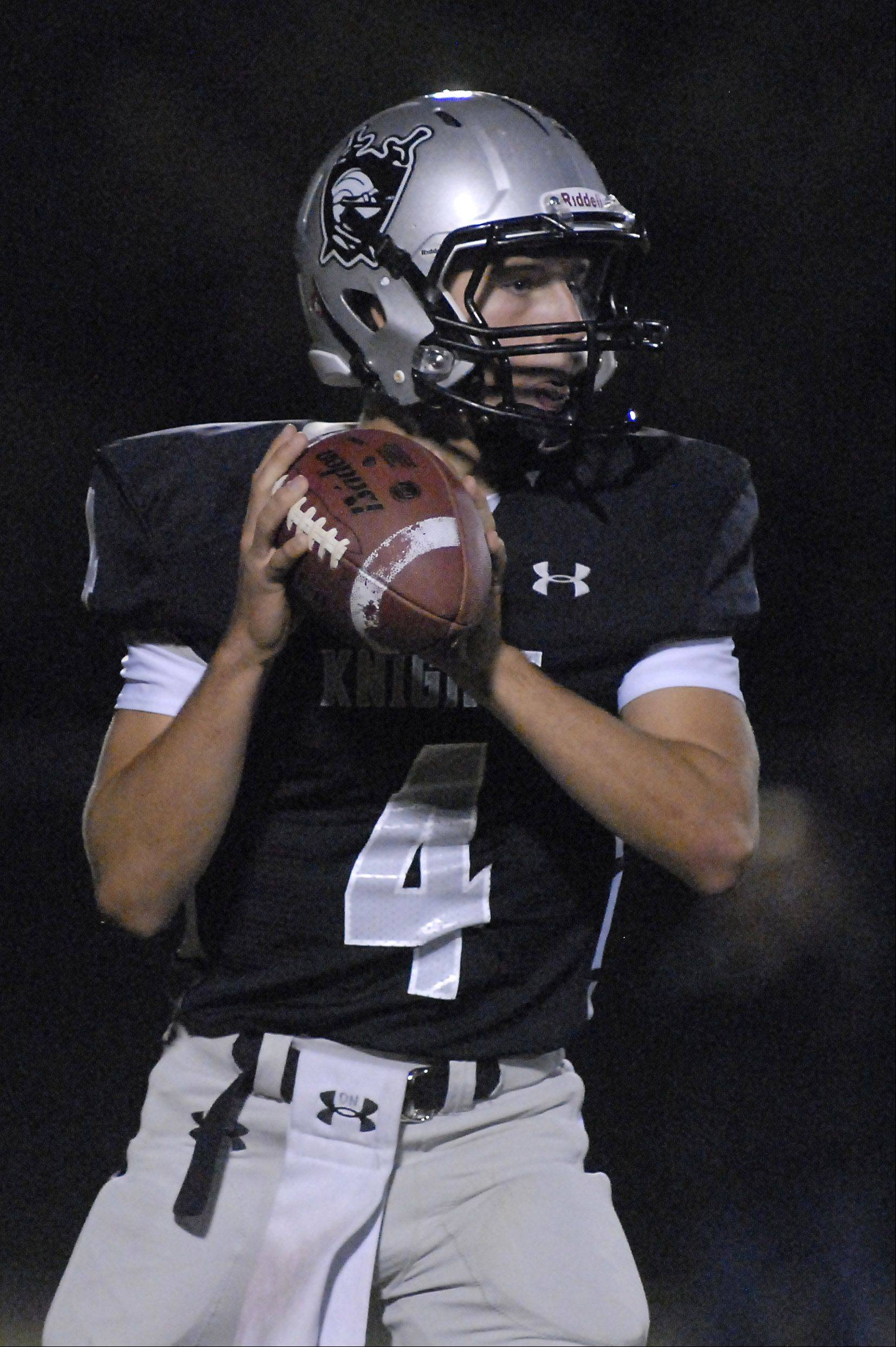 Kaneland quarterback Drew David looks to pass in the second quarter.