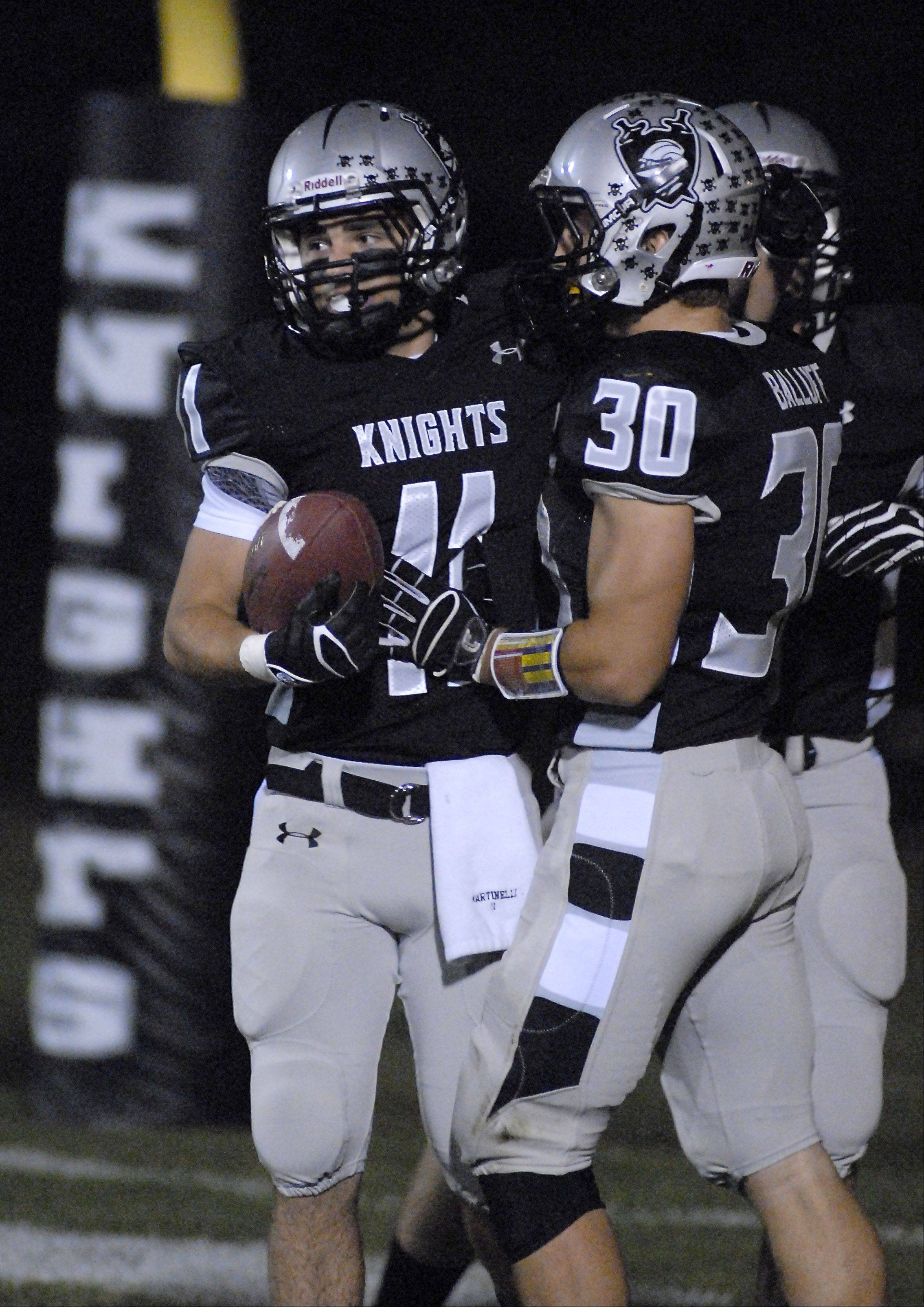 Kaneland's Zack Martinelli gets props from teammate Jesse Balluff after a touchdown.