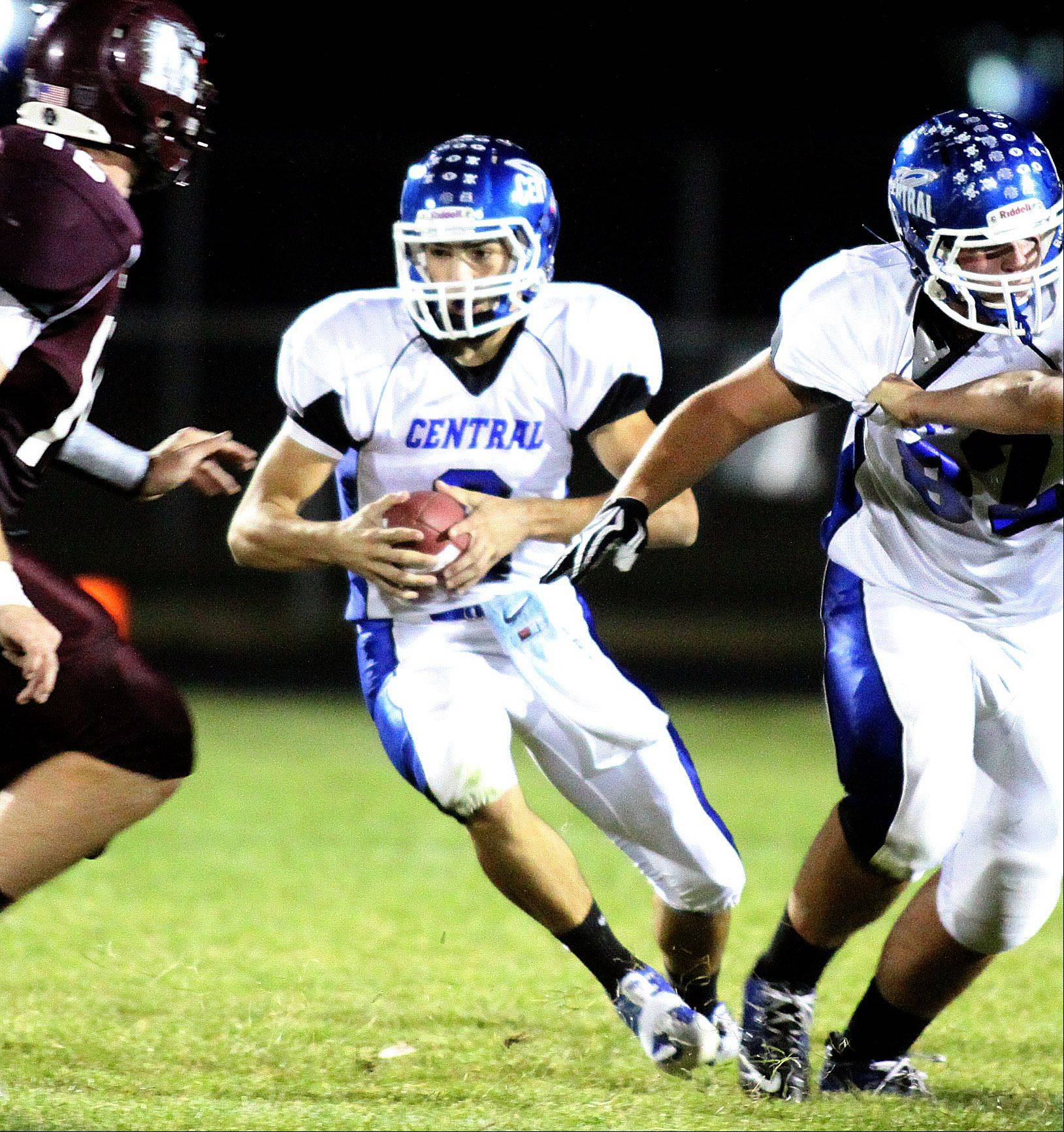 Burlington Central's quarterback Tyler Majewski moves with the ball during a varsity football game at Rod Poppe Field in Marengo on Friday night.