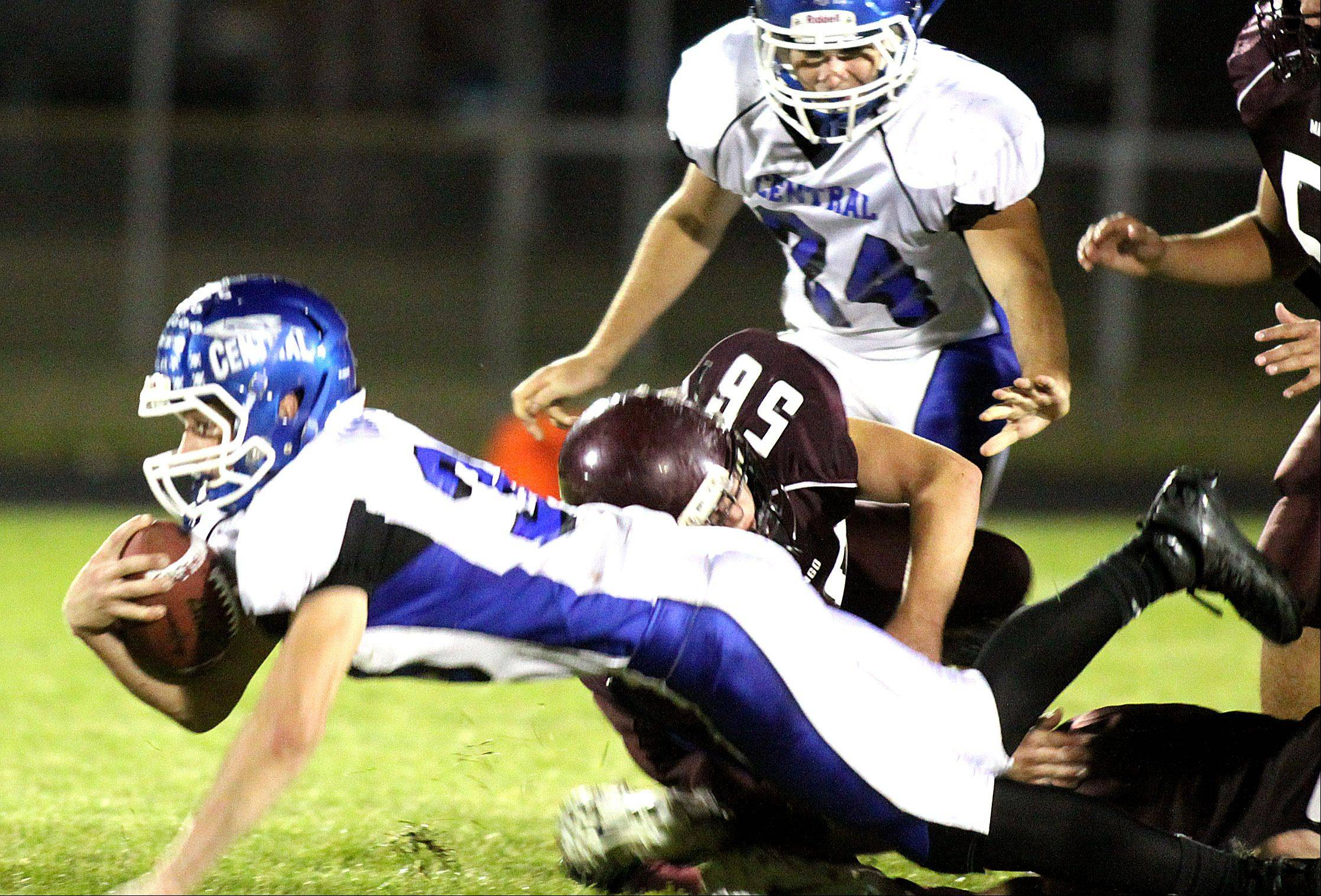 Burlington Central's Reilly Marino dives for yardage in the first half during a varsity football game at Rod Poppe Field in Marengo on Friday night.