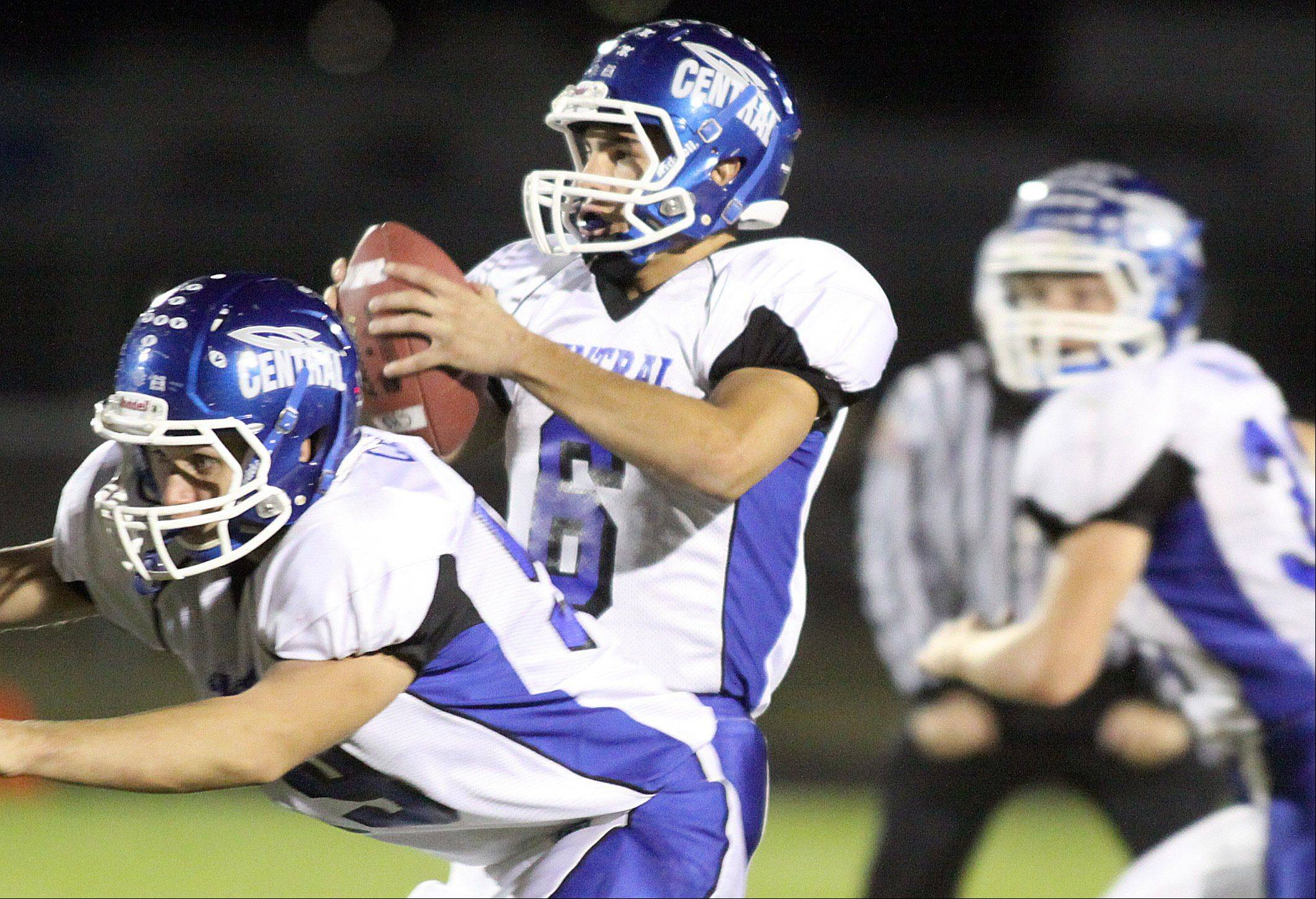 Burlington Central's quarterback Tyler Majewski prepares to throw the ball during a varsity football game at Rod Poppe Field in Marengo on Friday night.