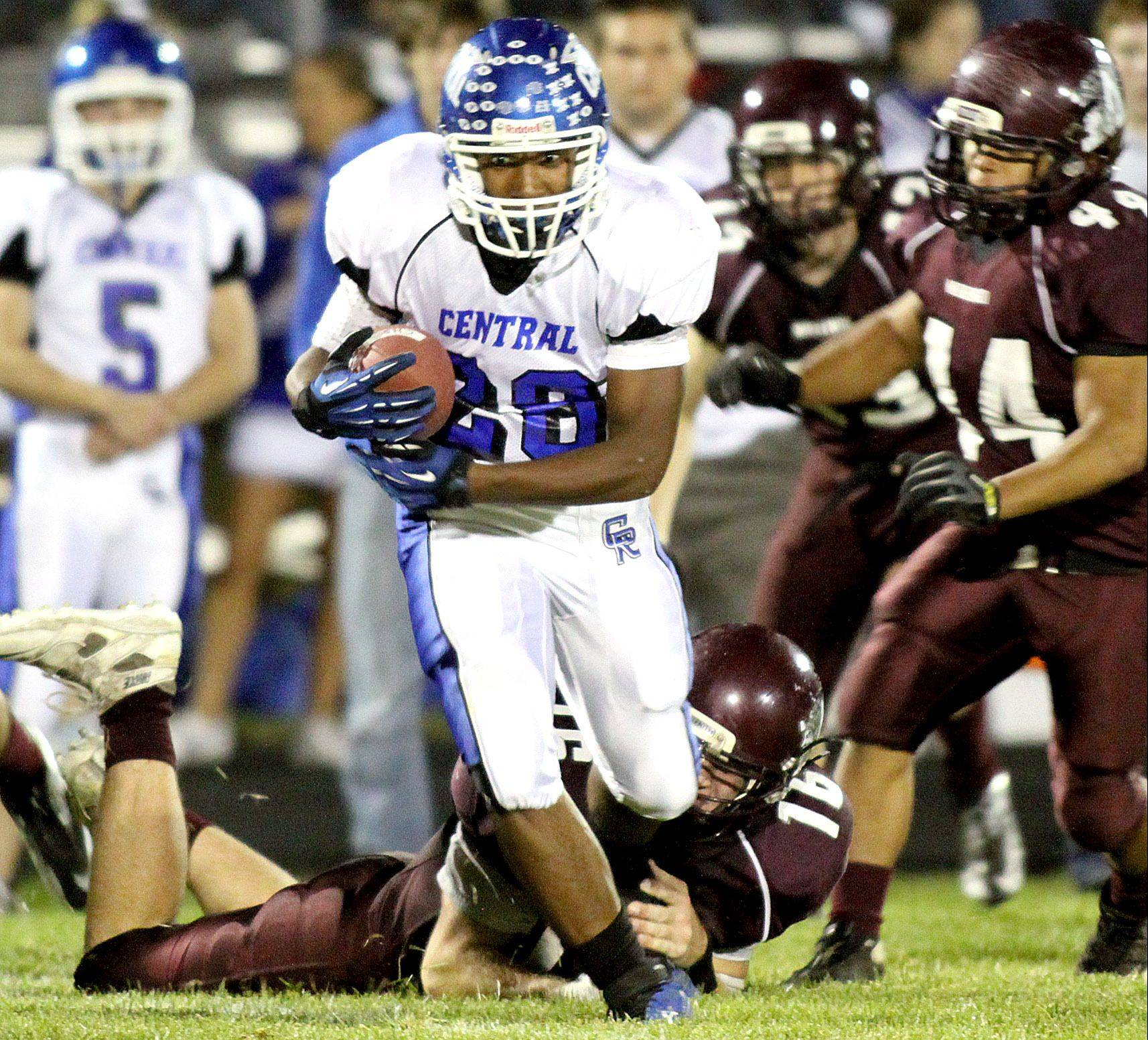 Burlington Central's Trevor Davison moves the ball during a varsity football game at Rod Poppe Field in Marengo on Friday night.