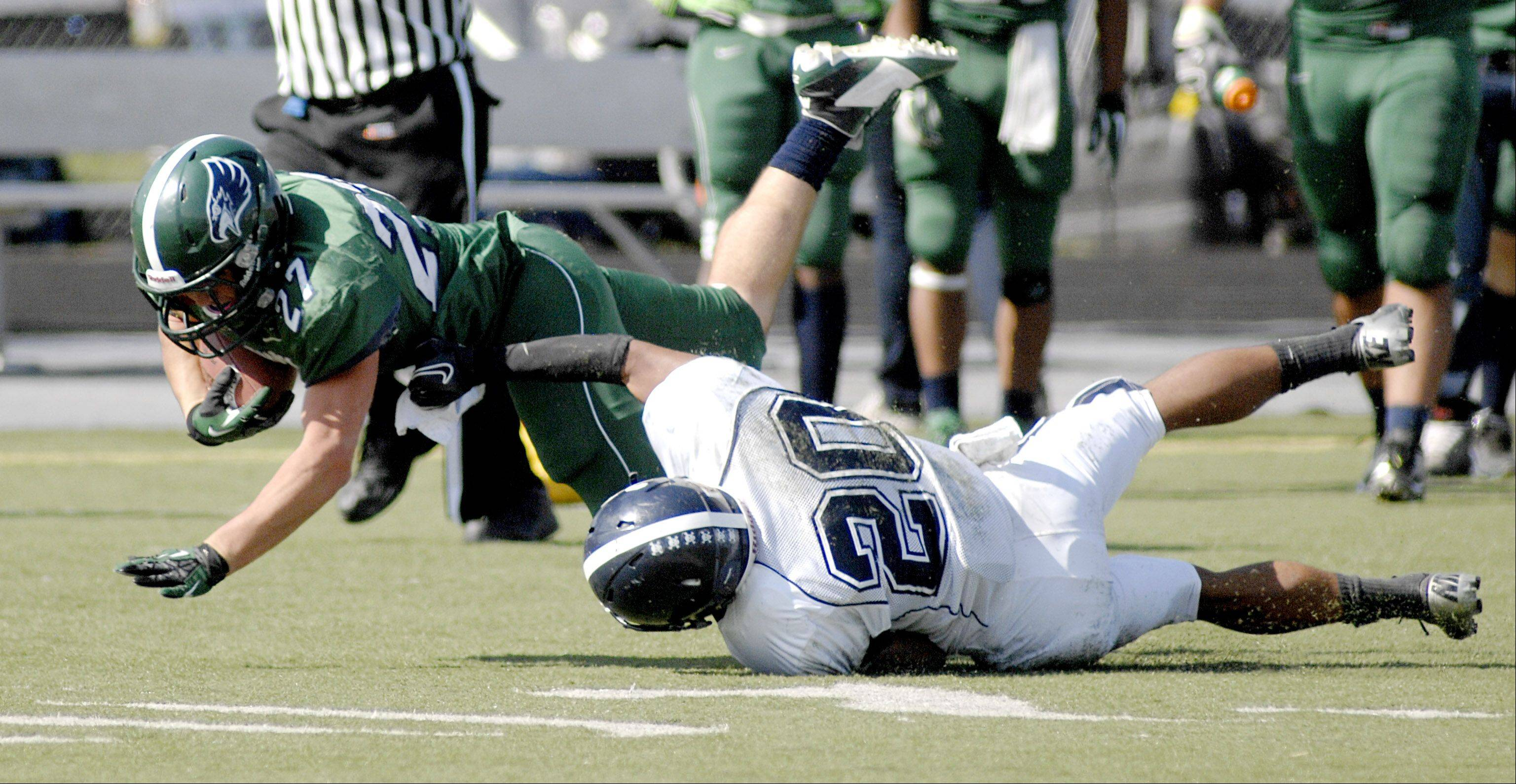 Bartlett's Aaron Everson is taken down by Lake Park's Antonio Shenault in the second quarter on Saturday, September 30.
