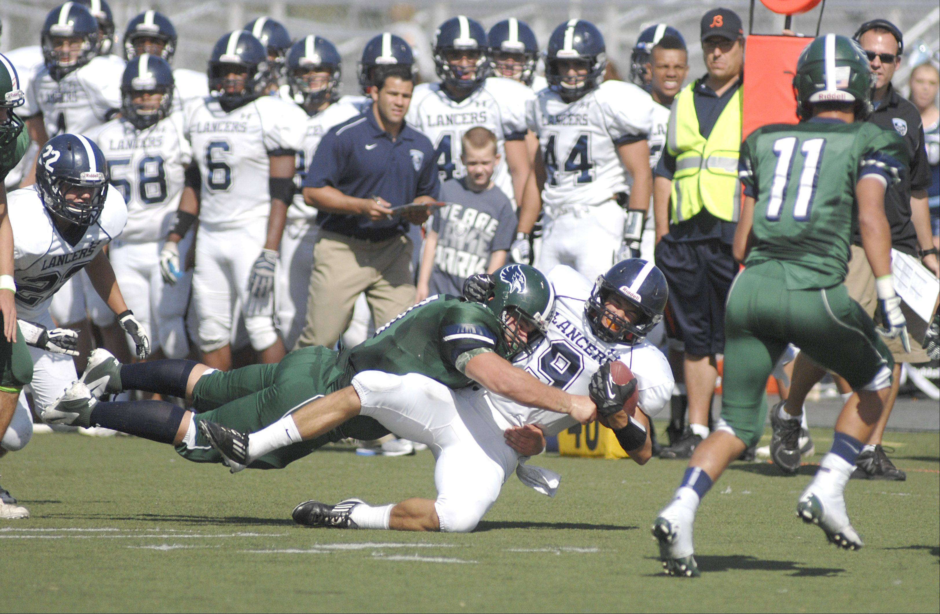 Bartlett's Kevin Kirchhoff tackles Lake Park's Scott Filip in the first quarter on Saturday, September 30.