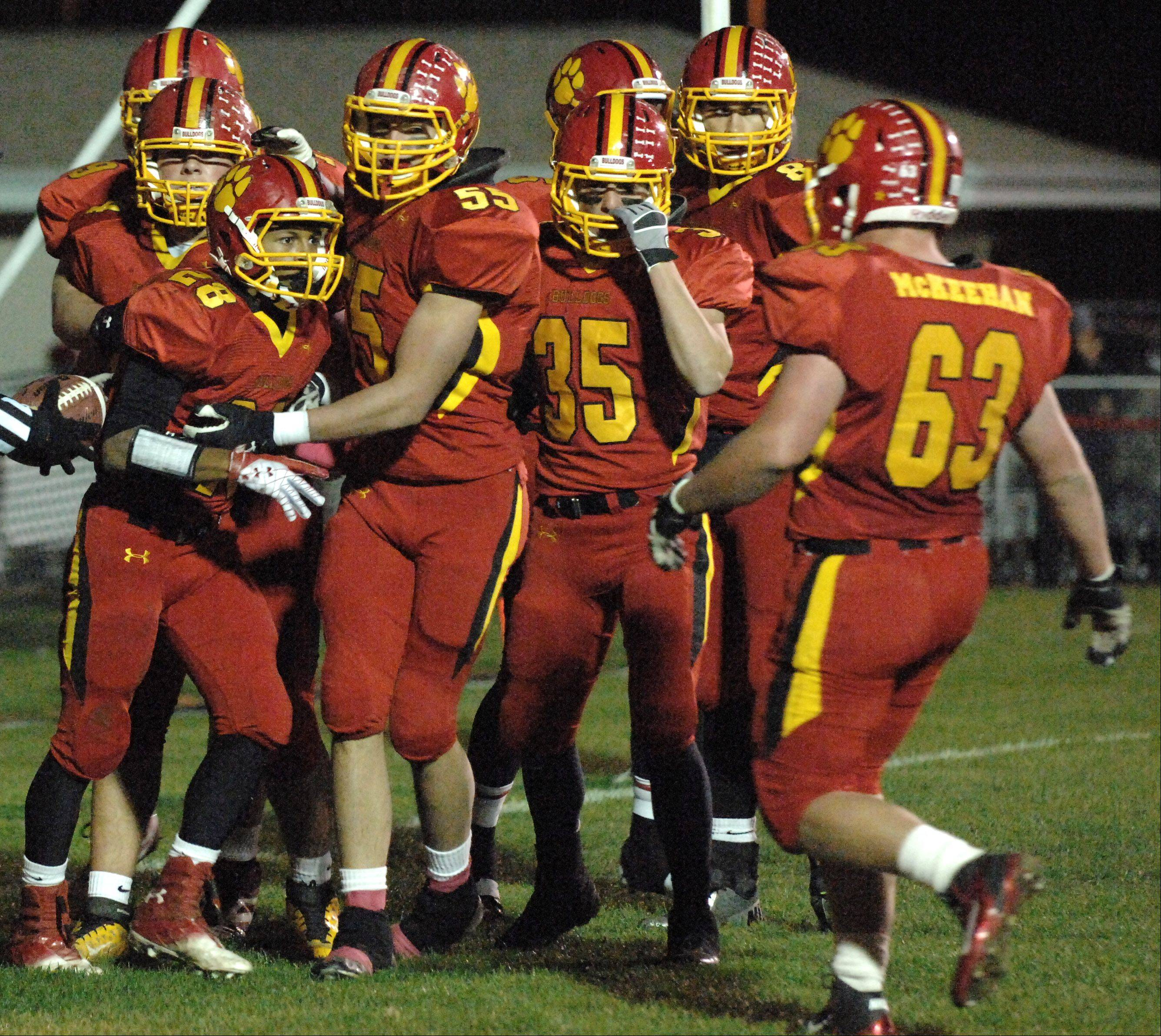 Batavia teammates congratulate Anthony Scaccia (28) after a third quarter touchdown during Friday's game at Batavia.