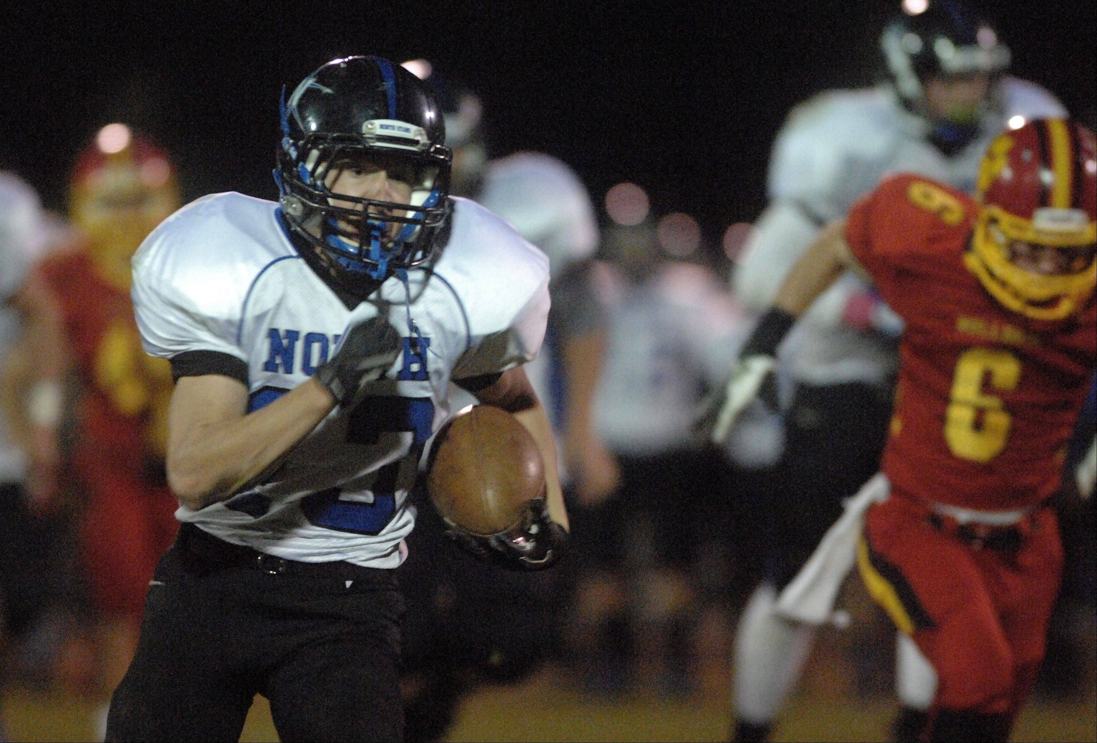 St. Charles North's Zachary Kirby turns a short catch into a 59-yard touchdown.