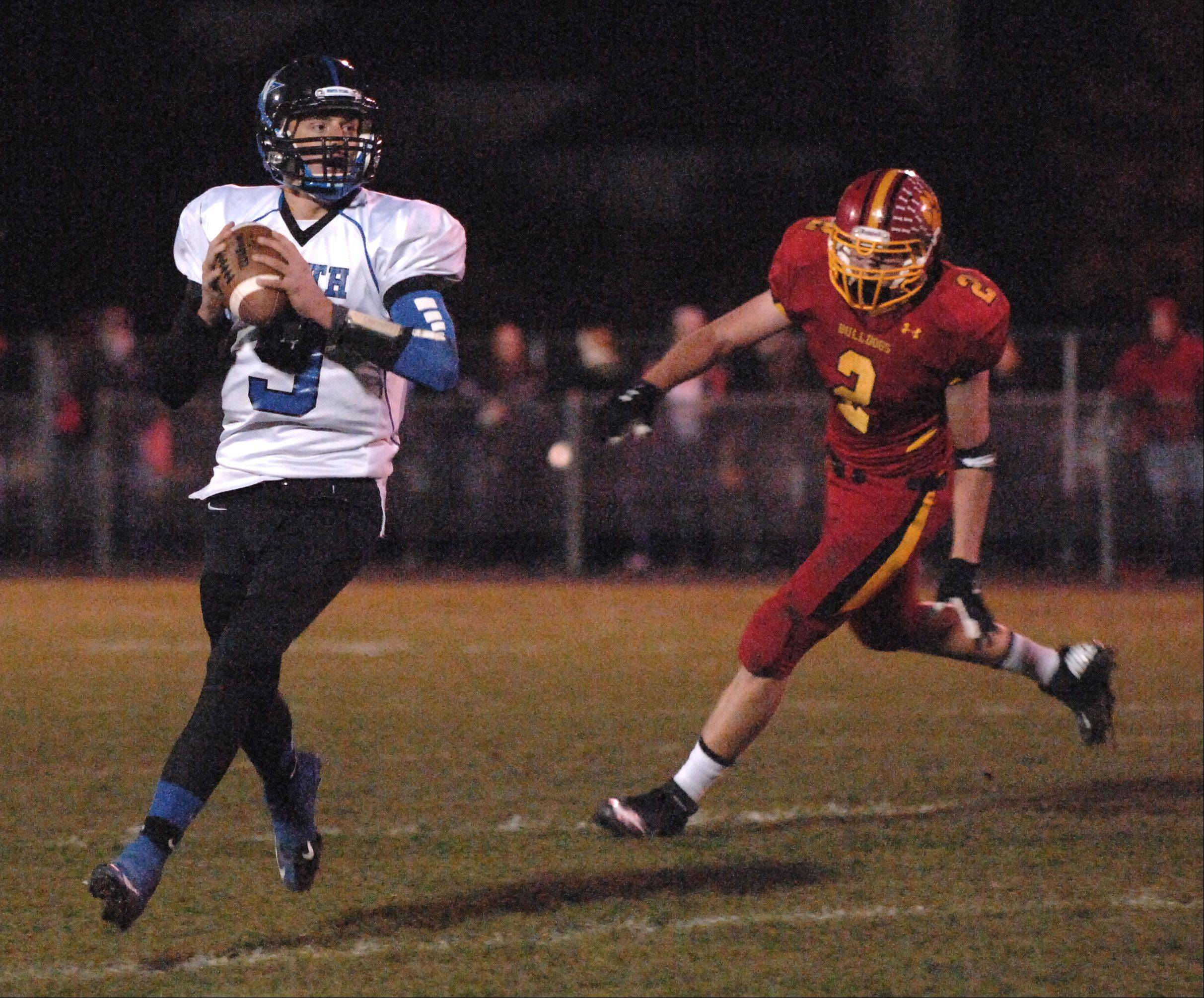 St. Charles North quarterback Ryan Fischbach looks for a receiver.