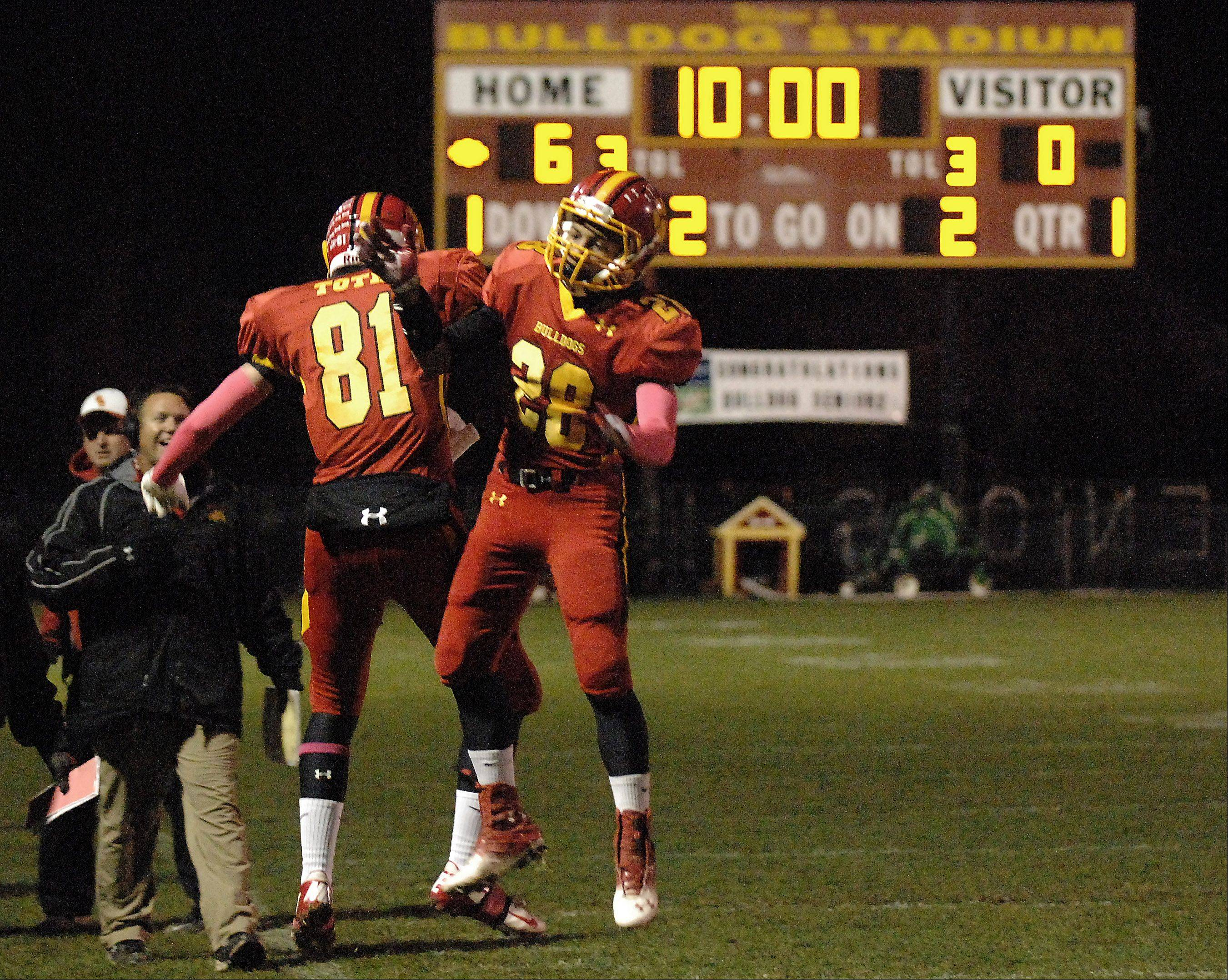 Batavia's Anthony Scaccia is congratulated by teammate Jason Toth after a touchdown run.