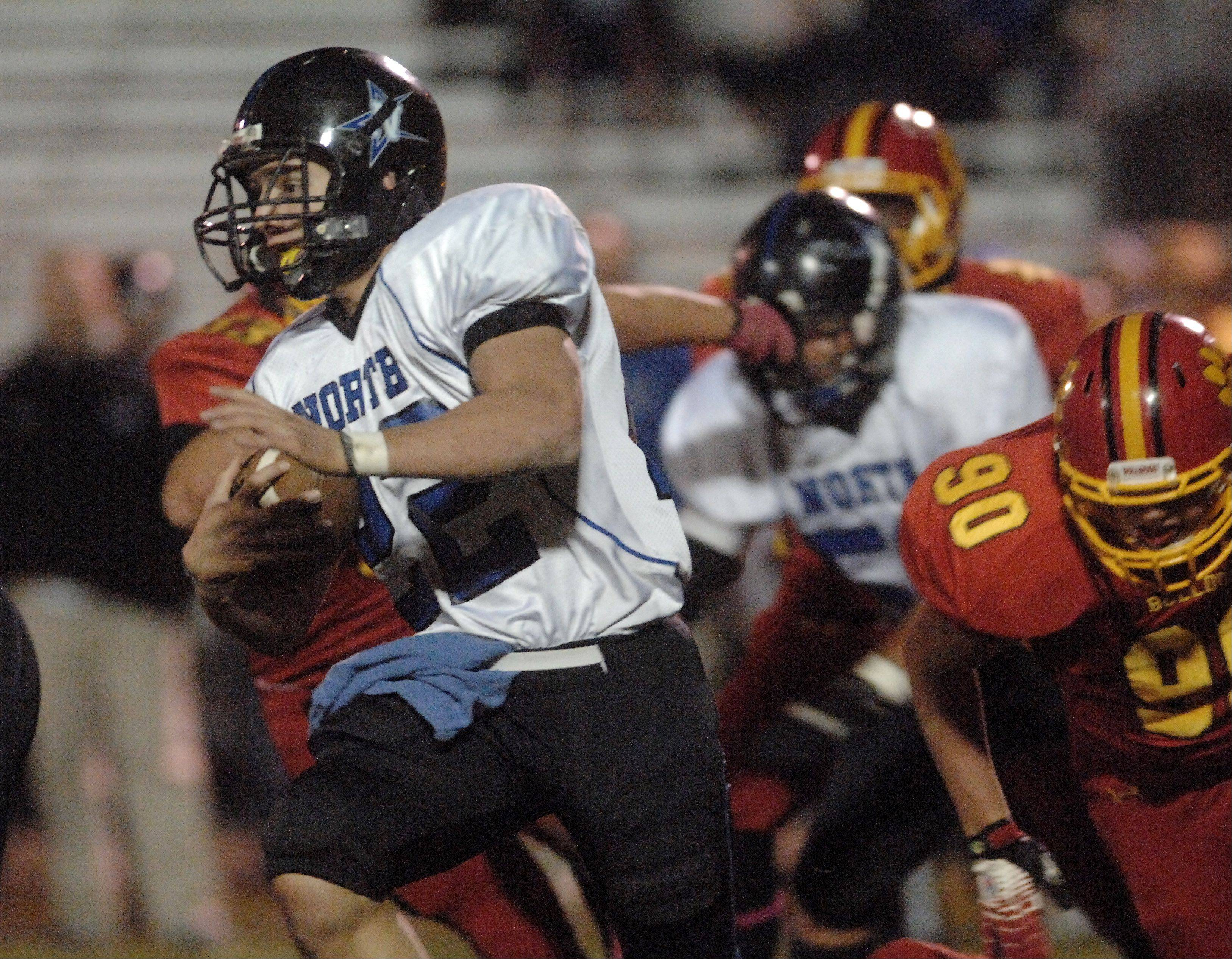 St. Charles North's George Edlund finds some room to run.