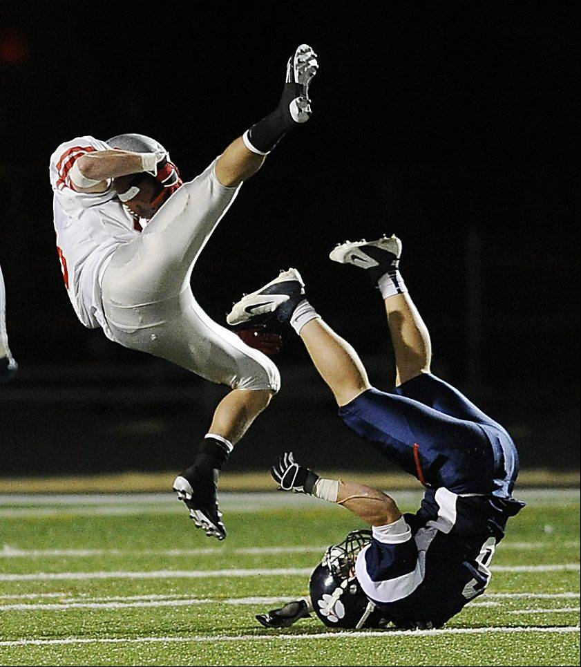 Palatine's Alex Nawrot goes flying over Conant's Kramer Brandt late in the second quarter on a pass play.