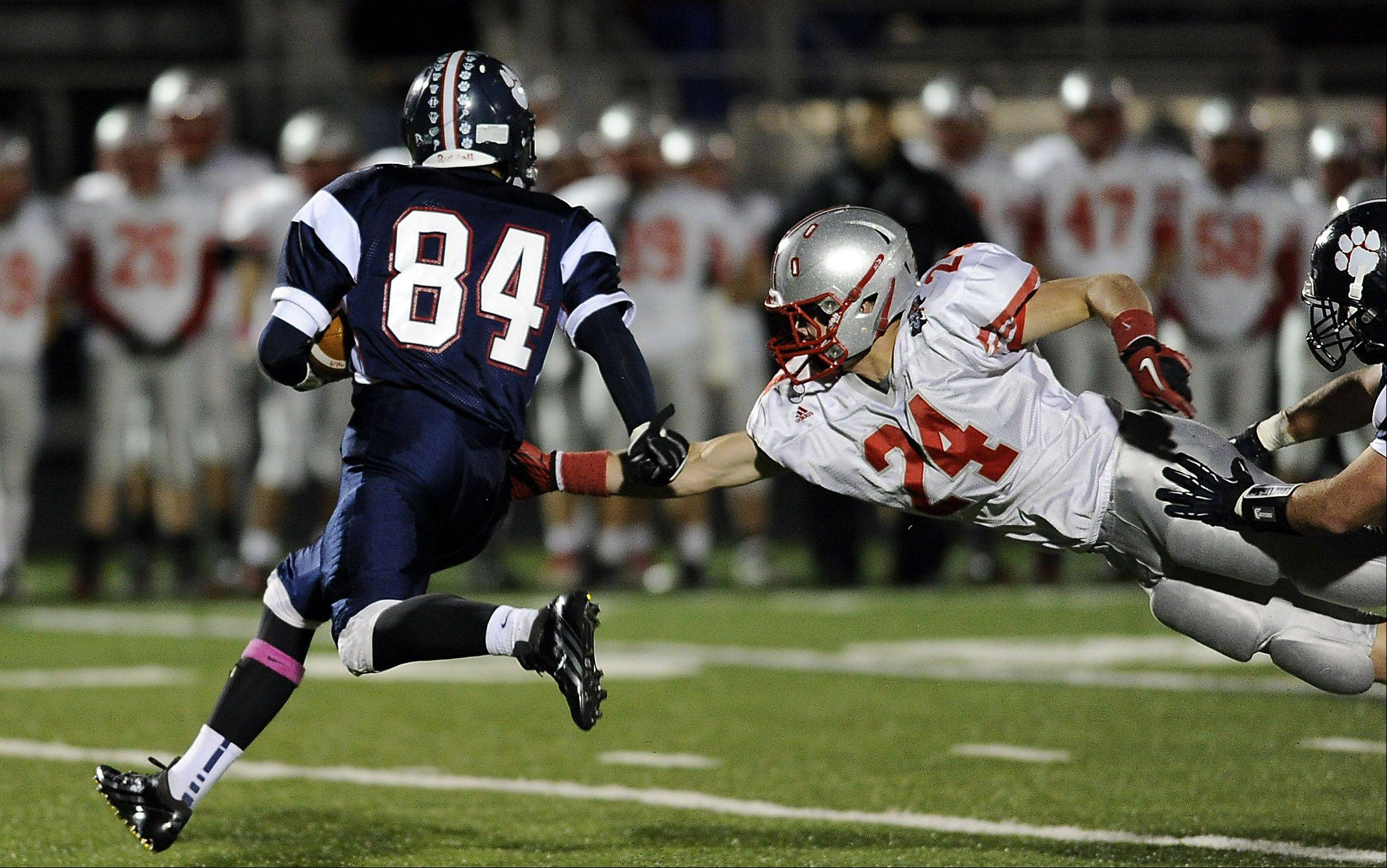 Palatine's Dan Riddle makes an attempt to stop a run by Conant's Tim Manczko.