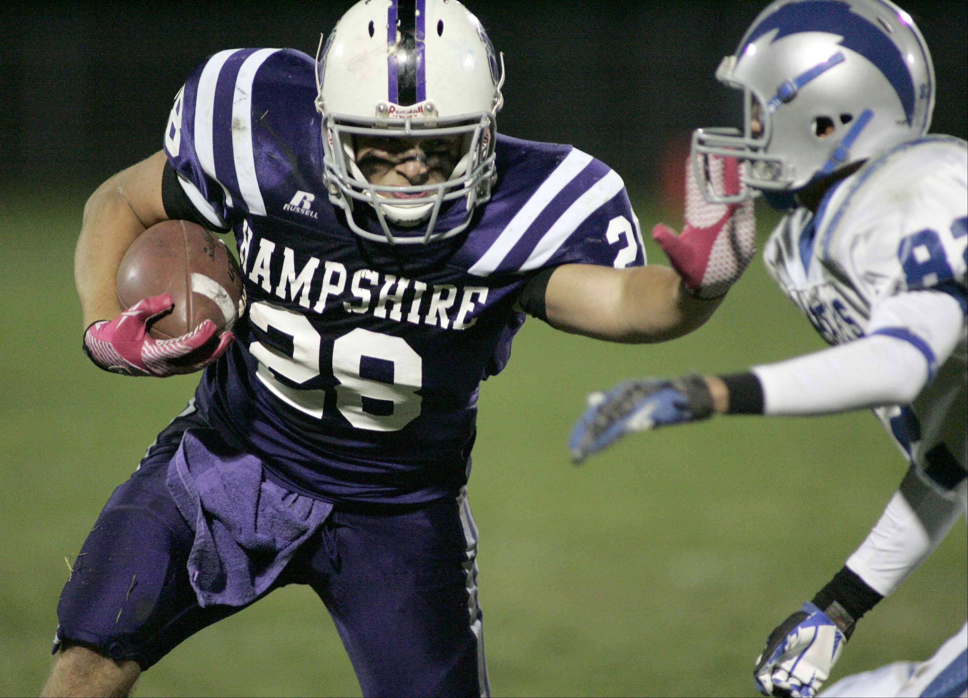 Hampshire's Philip LaPointe pushes past Woodstock's Preston Tio .