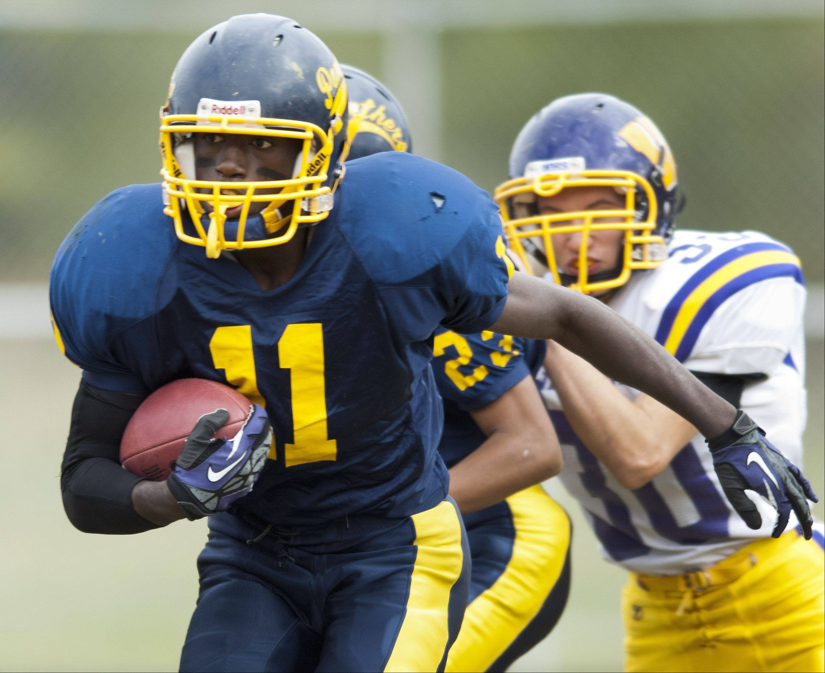 Round Lake's Chris Washington carries the ball during Saturday's game against Wauconda.