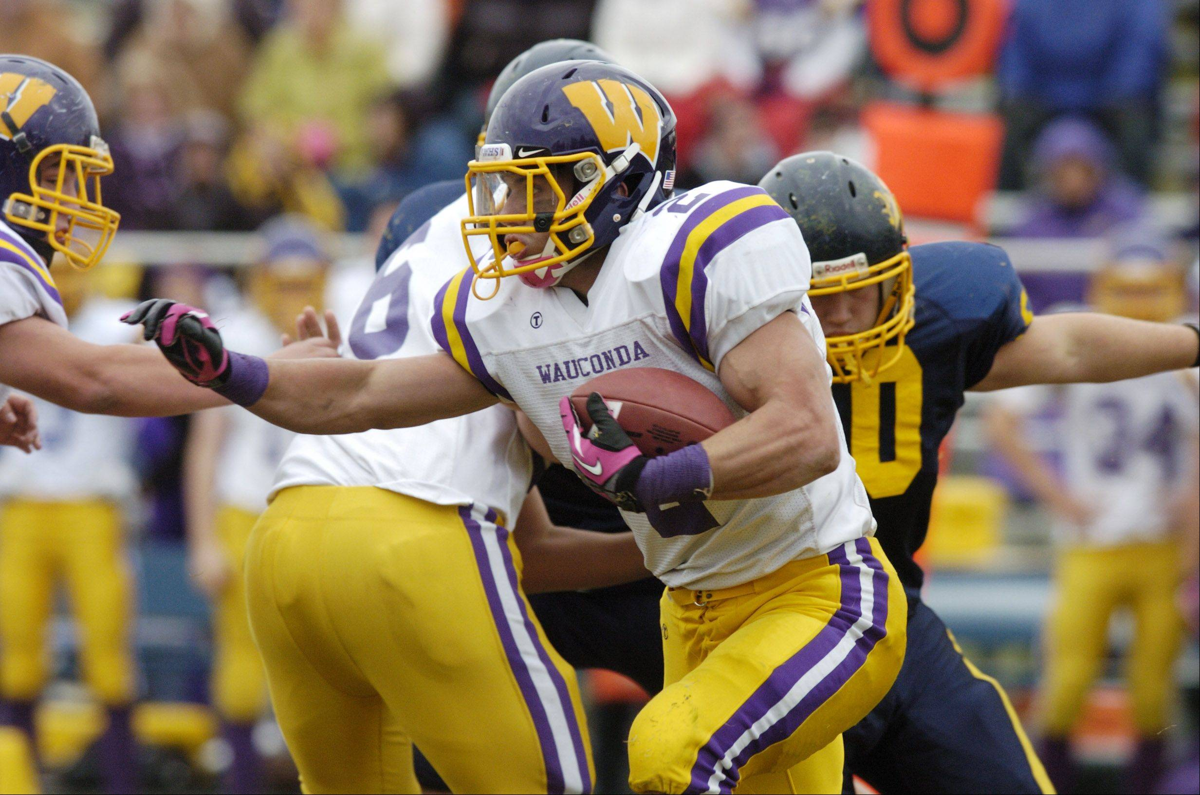 Wauconda's David Starkey carries the ball during Saturday's game against Round Lake.